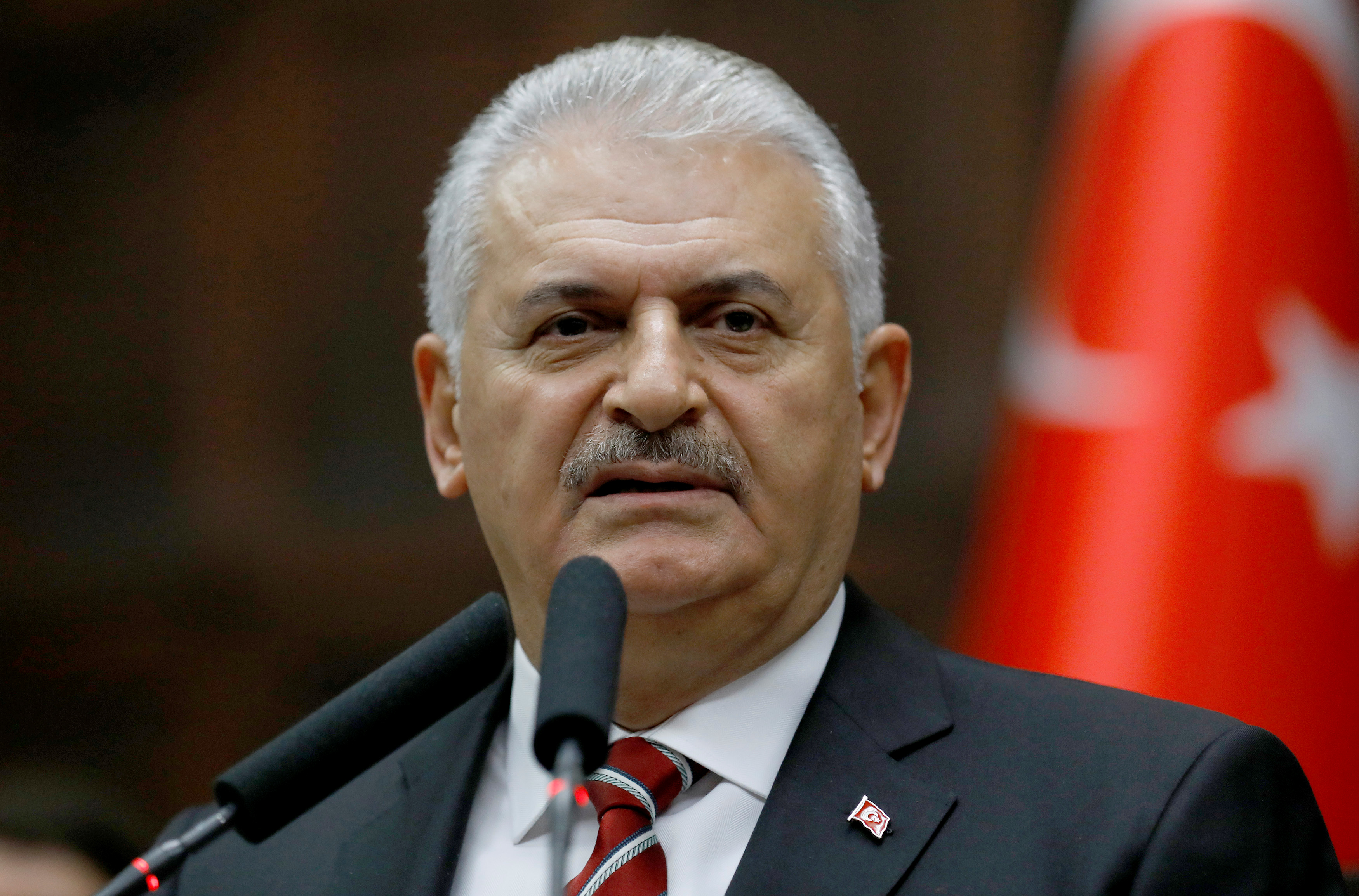 Binali Yildirim addresses members of parliament in Ankara, Turkey, Nov. 8, 2016. The prime minister says the constitutional changes will take one more meeting to iron out the details.