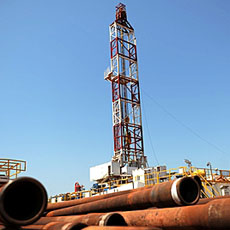 Drilling tubing is piled next to the drilling site number 102 in the Unity oil field in South Sudan (2010 file photo).