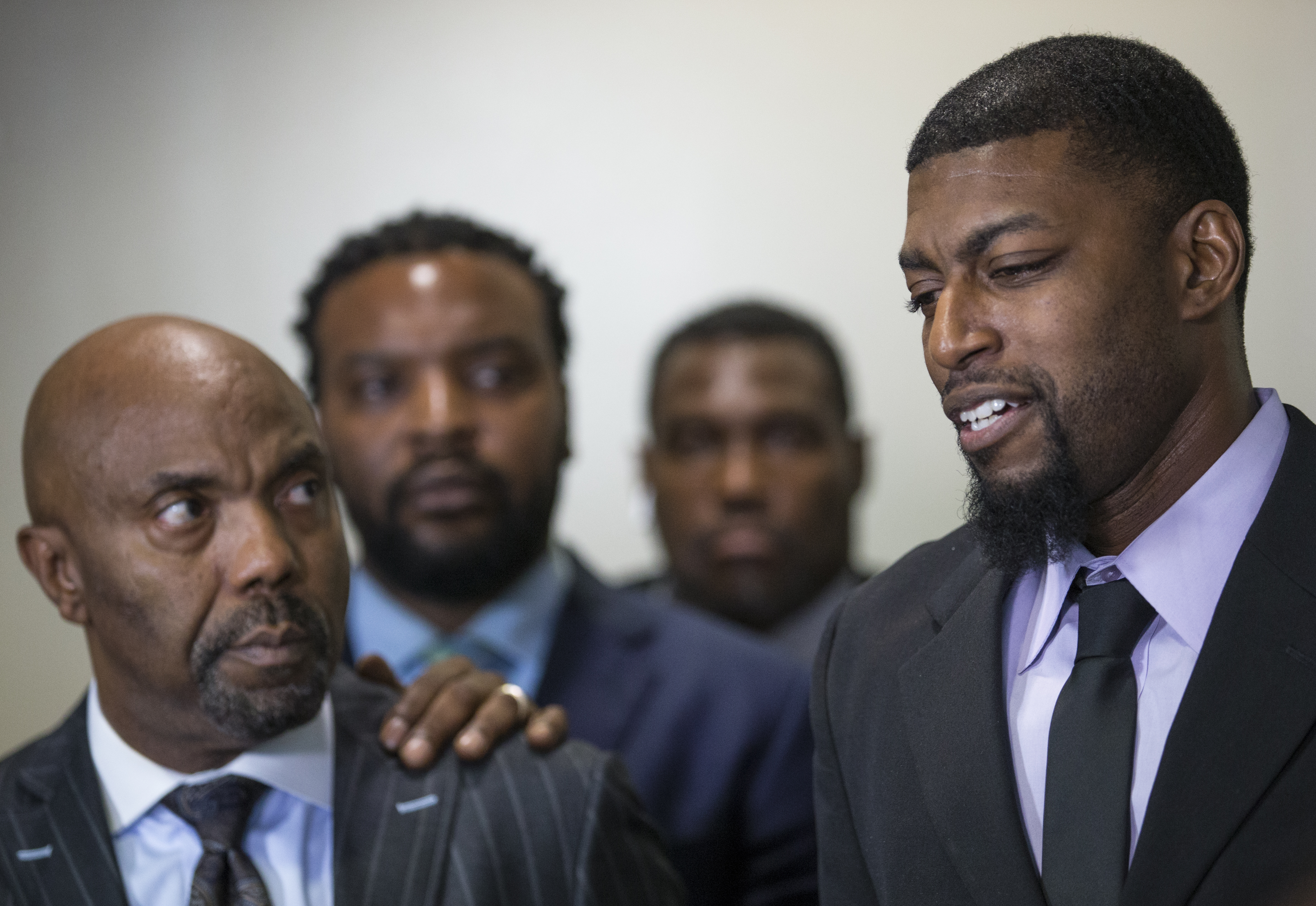 Alongside attorneys, Odell Edwards, right, father of Jordan Edwards, speaks to reporters at the Frank Crowley Courts Building in Dallas, on Aug. 28, 2018, after a Dallas County jury found Roy Oliver, a former Balch Springs police officer, guilty of m...