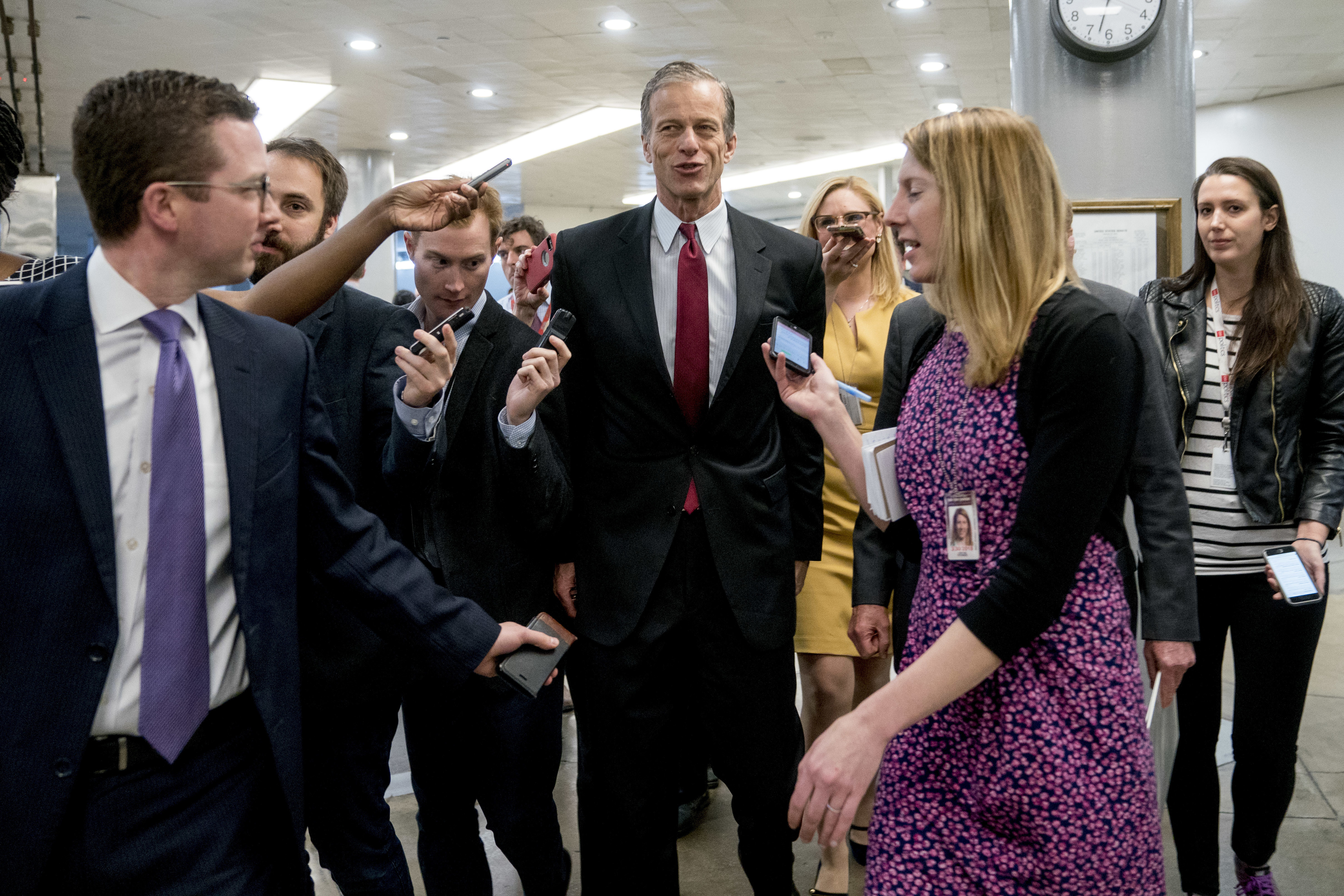 Sen. John Thune, R-S.D., speaks to reporters as he walks toward the Senate as Congress moves closer to the funding deadline to avoid a government shutdown on Capitol Hill in Washington, Jan. 18, 2018.