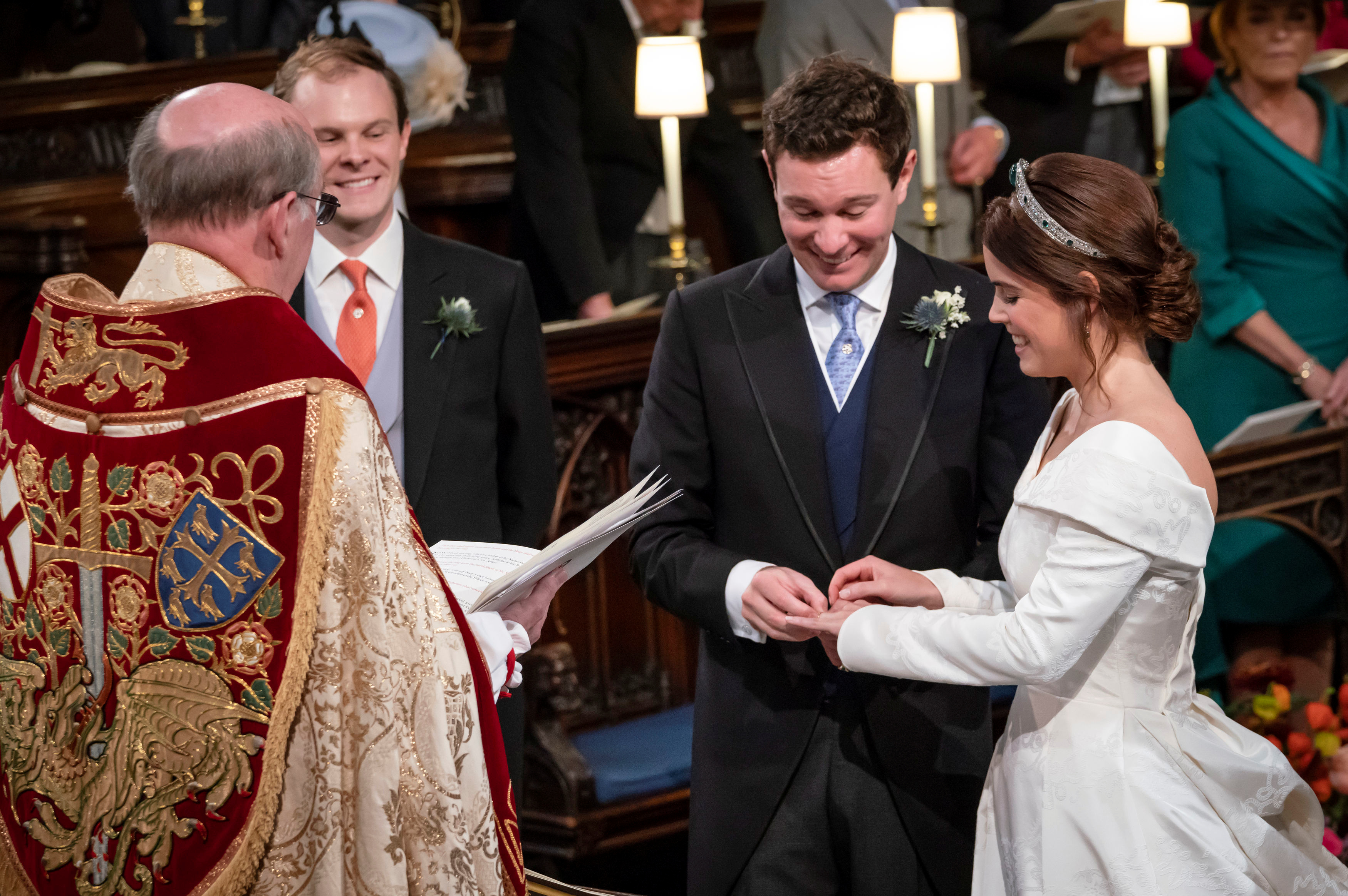 Princess Eugenie smiles as Jack Brooksbank put the ring on her finger during their wedding ceremony at St George's Chapel in Windsor Castle, Windsor, Britain, Oct.12, 2018.