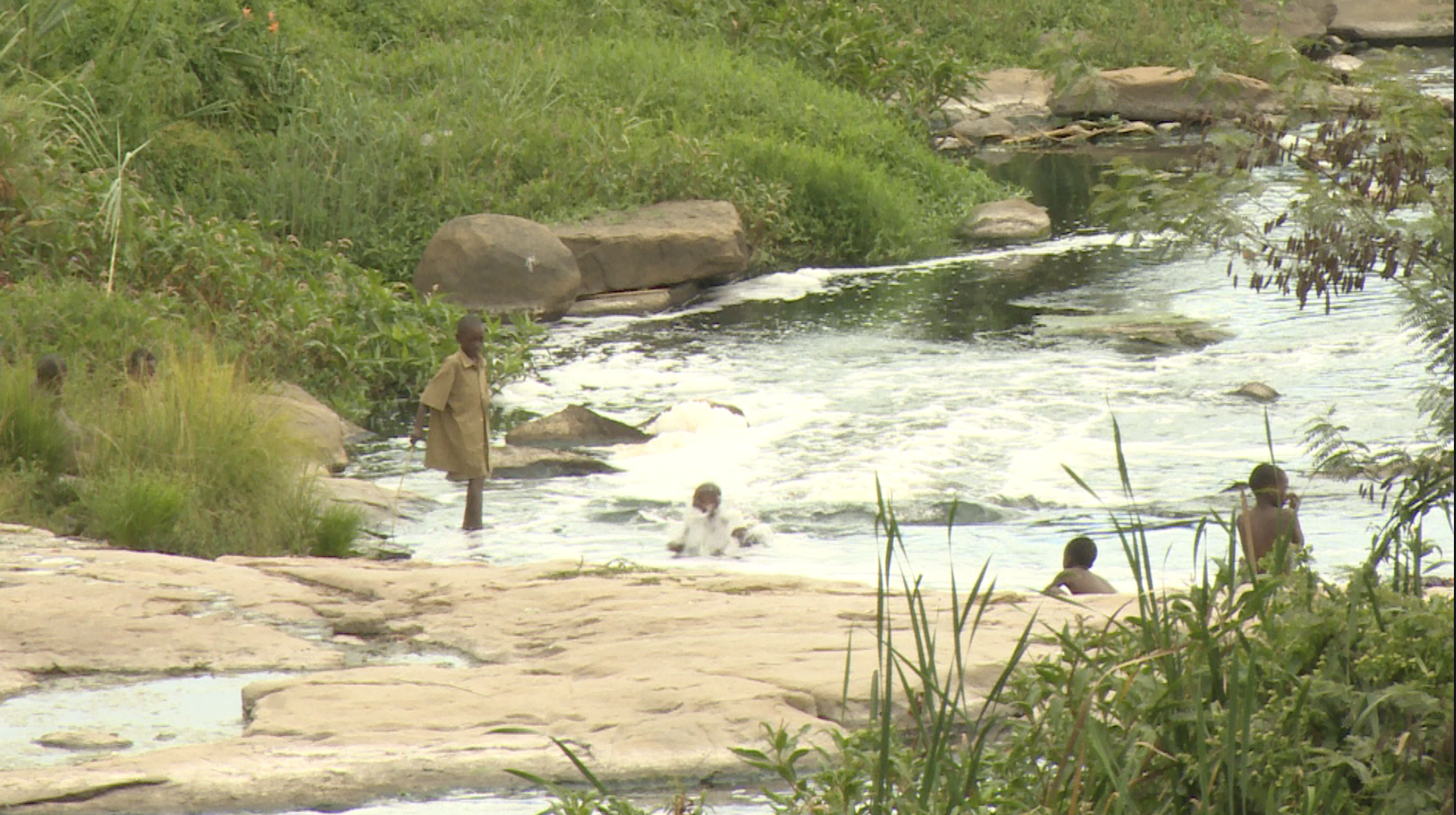 Children bath and swim in a river as people turn to unprotected sources of water in Harare, Zimbabwe, March 7, 2019.