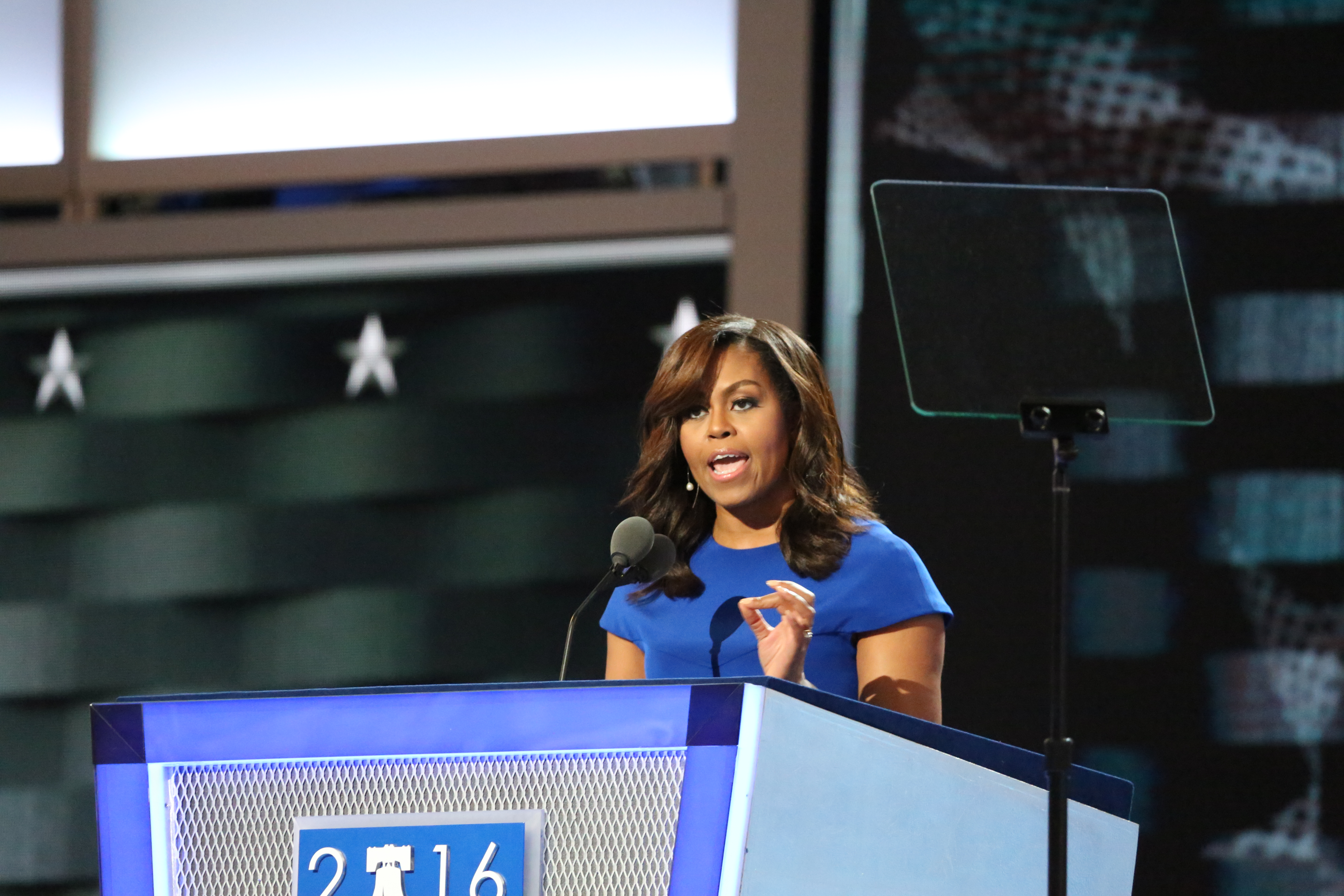 First lady Michelle Obama, speaking at the Democratic National Convention in Philadelphia, Pa., tells the audience, 'Don't let anyone ever tell you that this country isn't great.' (A. Shaker/VOA)