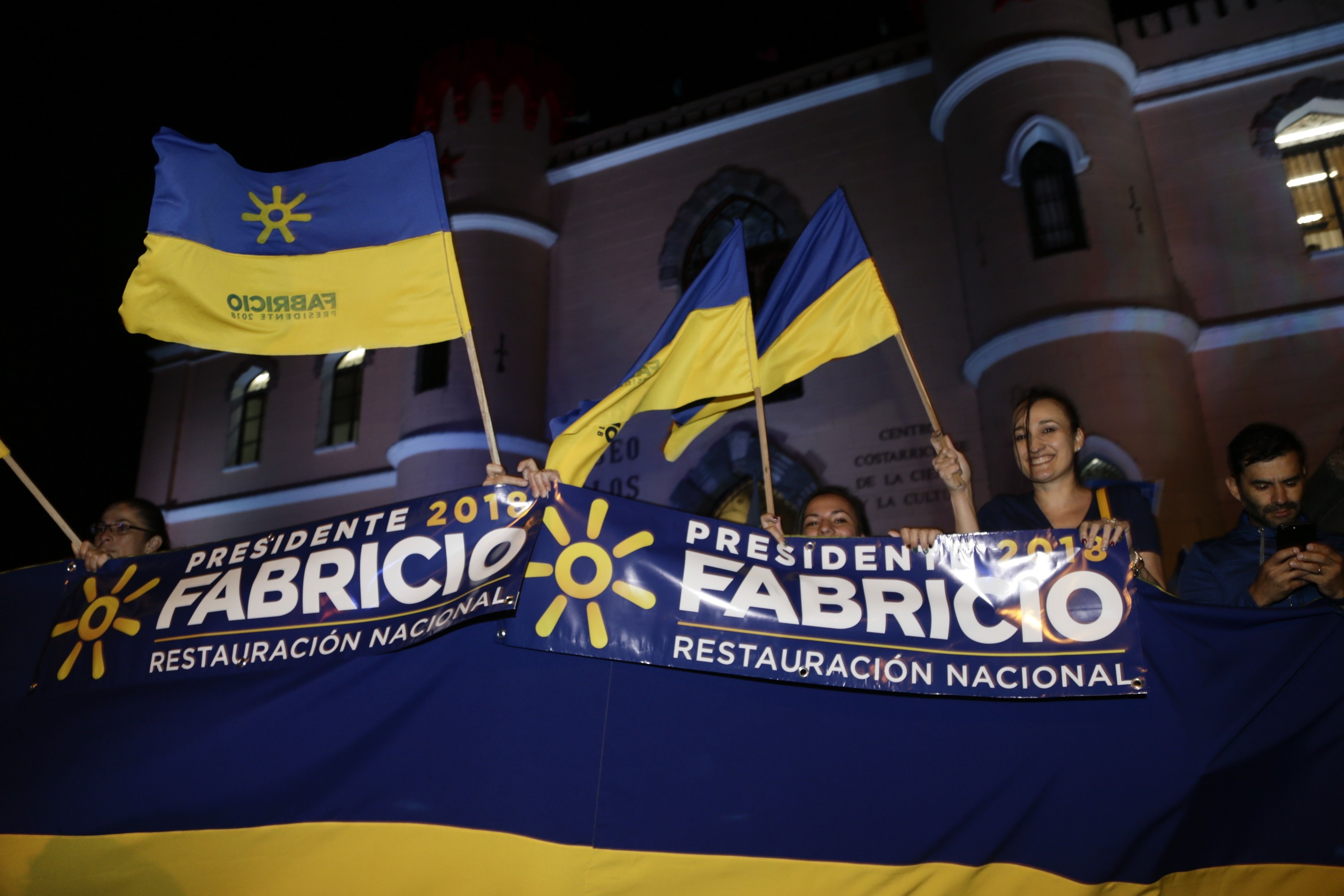 Supporters of presidential candidate Fabricio Alvarado with the National Restoration party gather before a debate ahead of the presidential election in San Jose, Costa Rica, Feb. 1, 2018. Costa Ricans head to the polls Sunday.