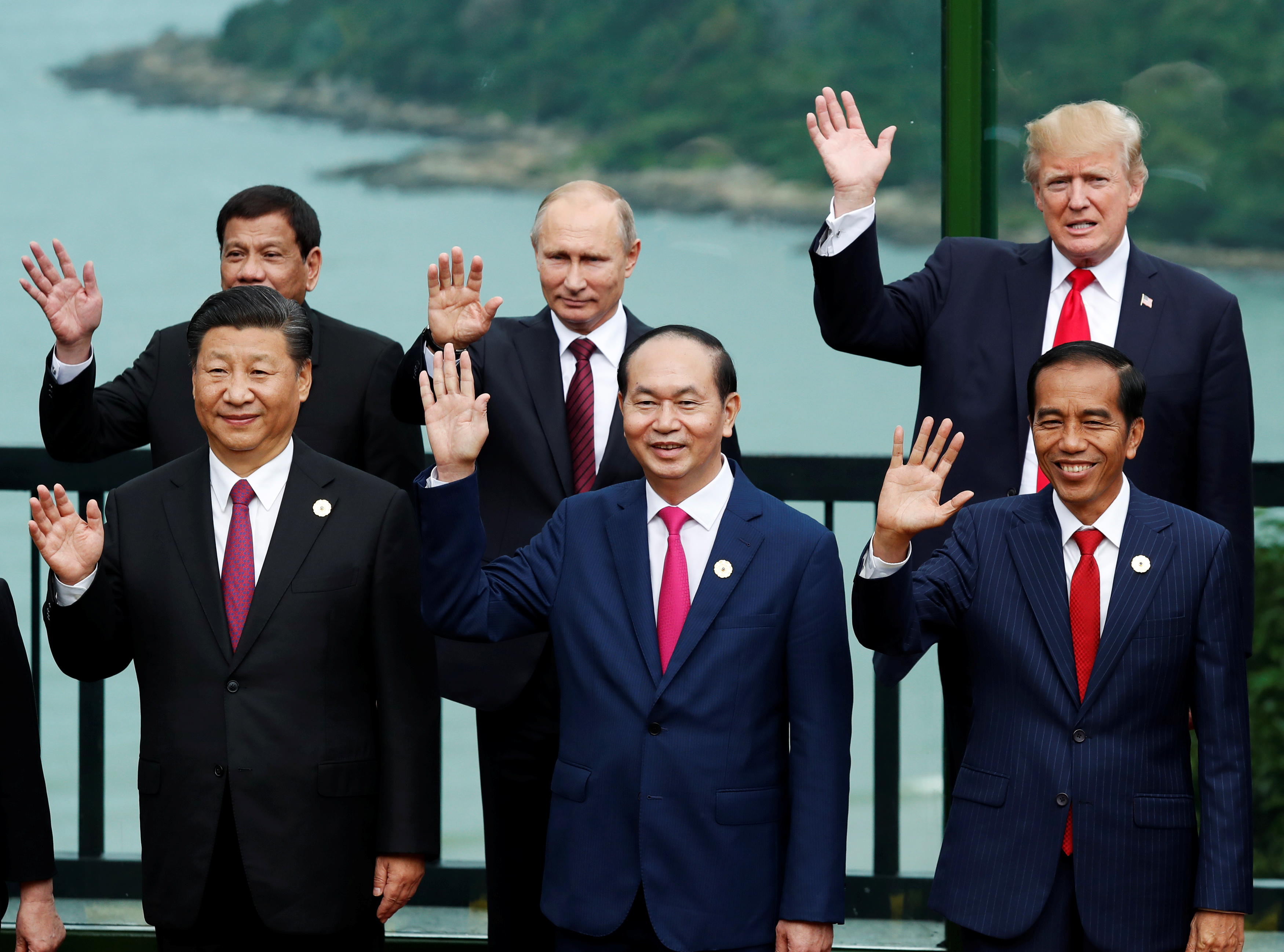 Leaders pose during the photo session at the APEC Summit in Danang, Vietnam, Nov. 11, 2017. Front, from left, China's President Xi Jinping, Vietnam's President Tran Dai Quang, Indonesia's President Joko Widodo; back, from left, Philippines' President...