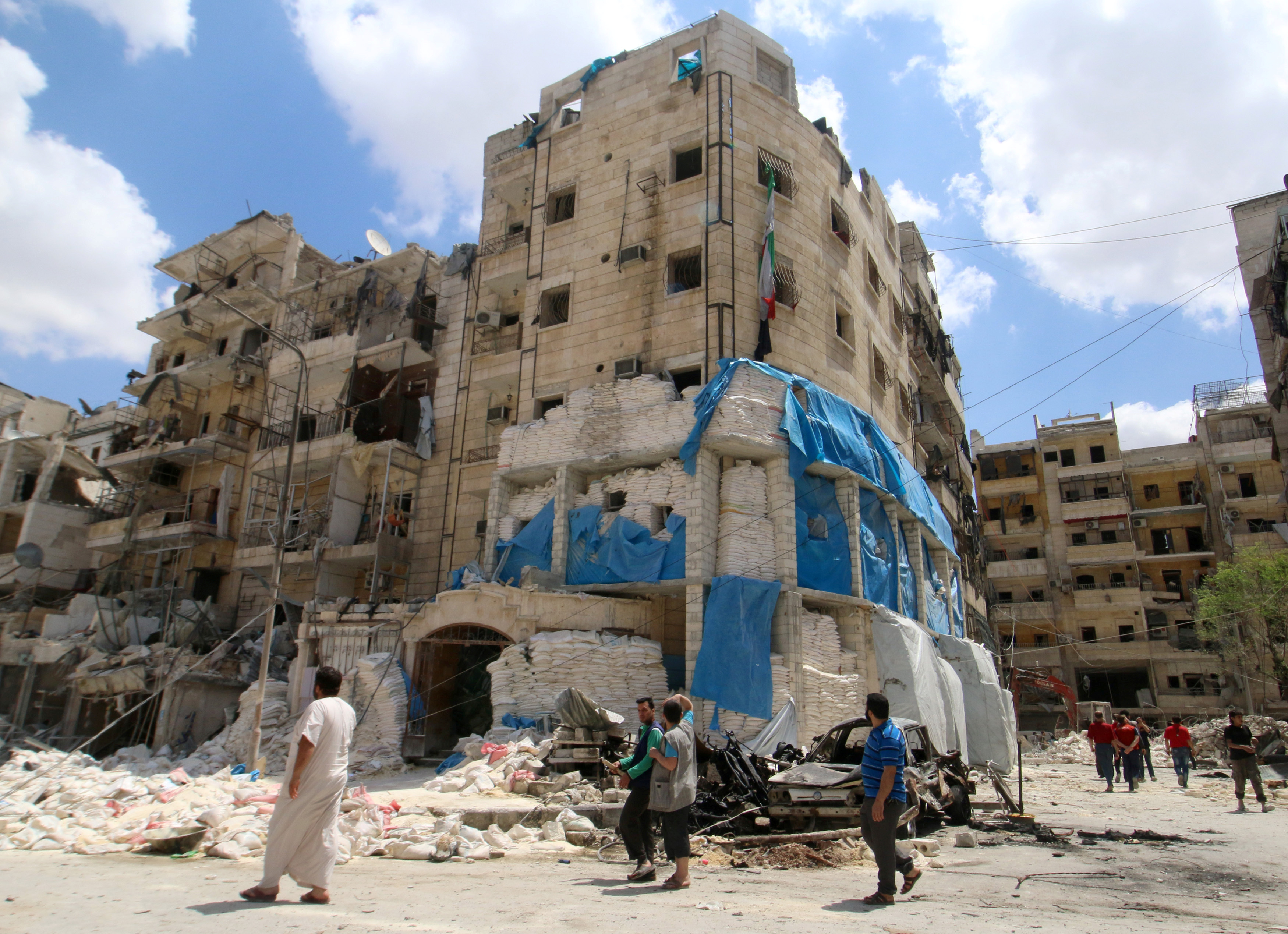 People inspect the damage at al-Quds hospital after it was hit by airstrikes, in a rebel-held area of Syria's Aleppo, April 28, 2016.