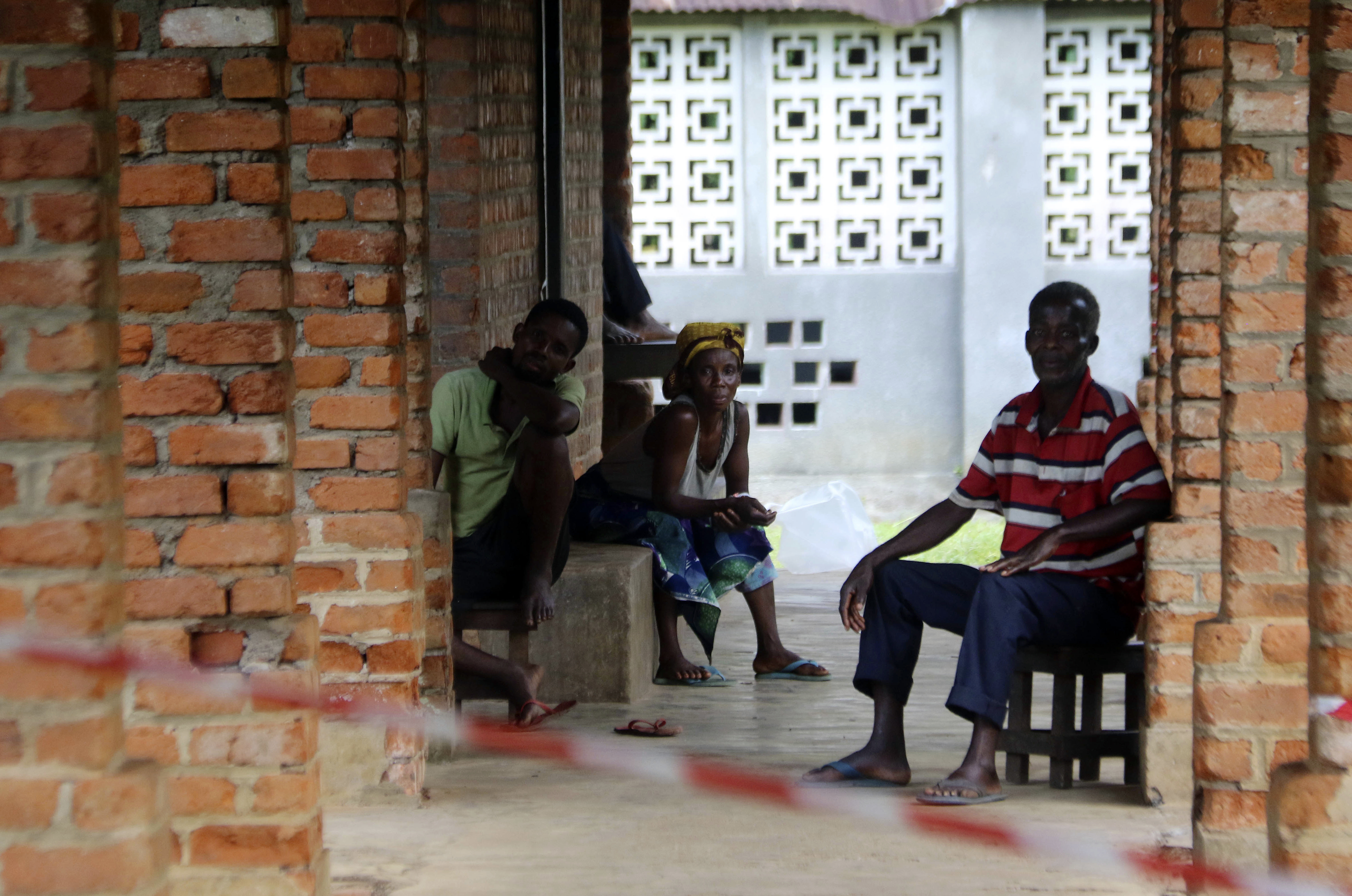 People suspected of having the Ebola virus wait at a treatment center in Bikoro, Democratic Republic of Congo, May 13, 2018. Congo's latest Ebola outbreak has spread to a city of more than 1 million people, a worrying shift as the deadly virus risks ...