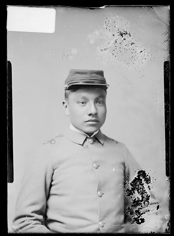 Portrait of Felix Eagle Feather in school uniform, Carlisle Indian Industrial School, Carlisle, Pa., by John N. Choate. Photo Lot 81-12 06850700, National Anthropological Archives, Smithsonian Institution, Washington, D.C.