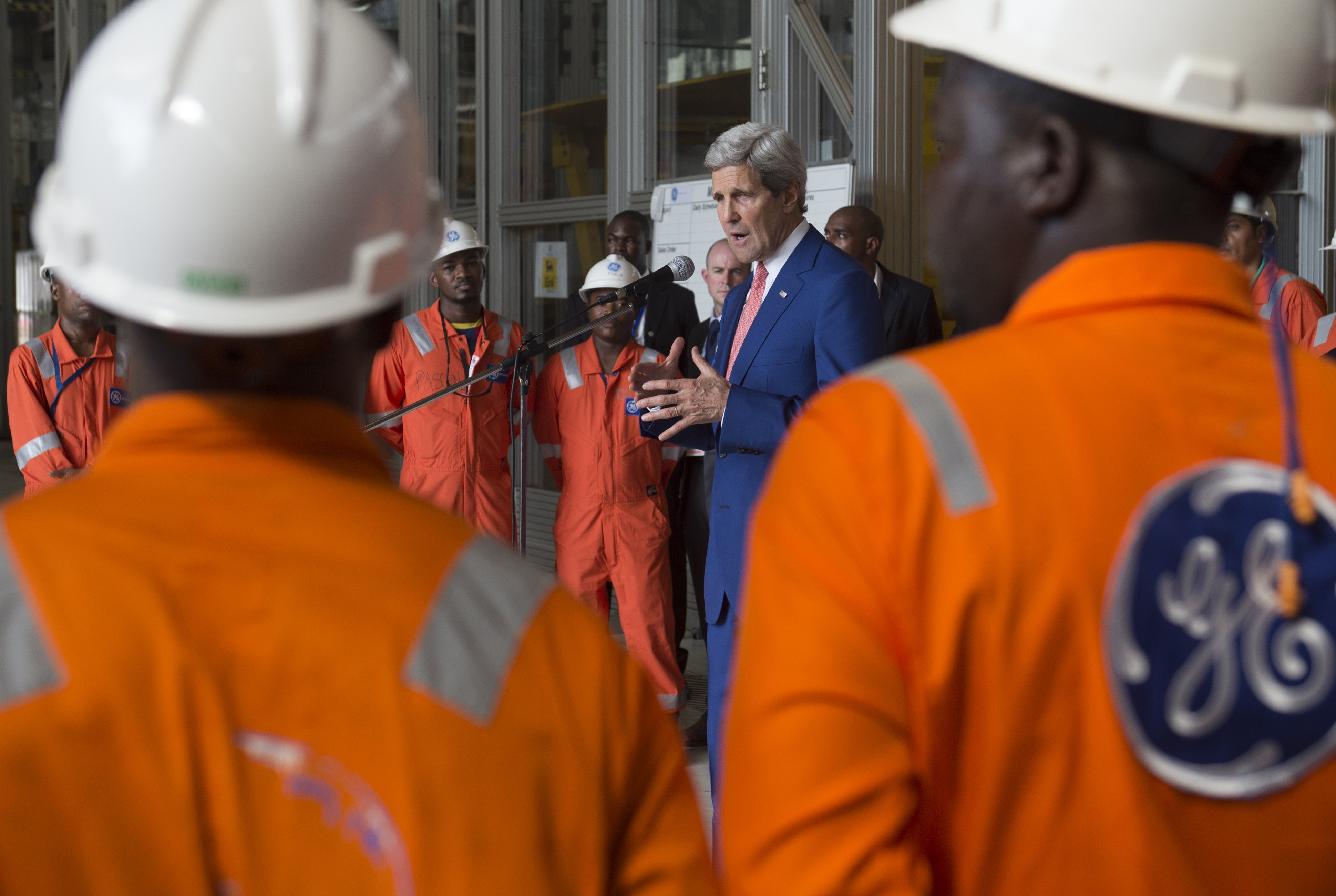 FILE - US Secretary of State John Kerry speaks as he poses with employees of the General Electric (GE) Sonils compound at the Port of Luanda in Luanda, Angola.