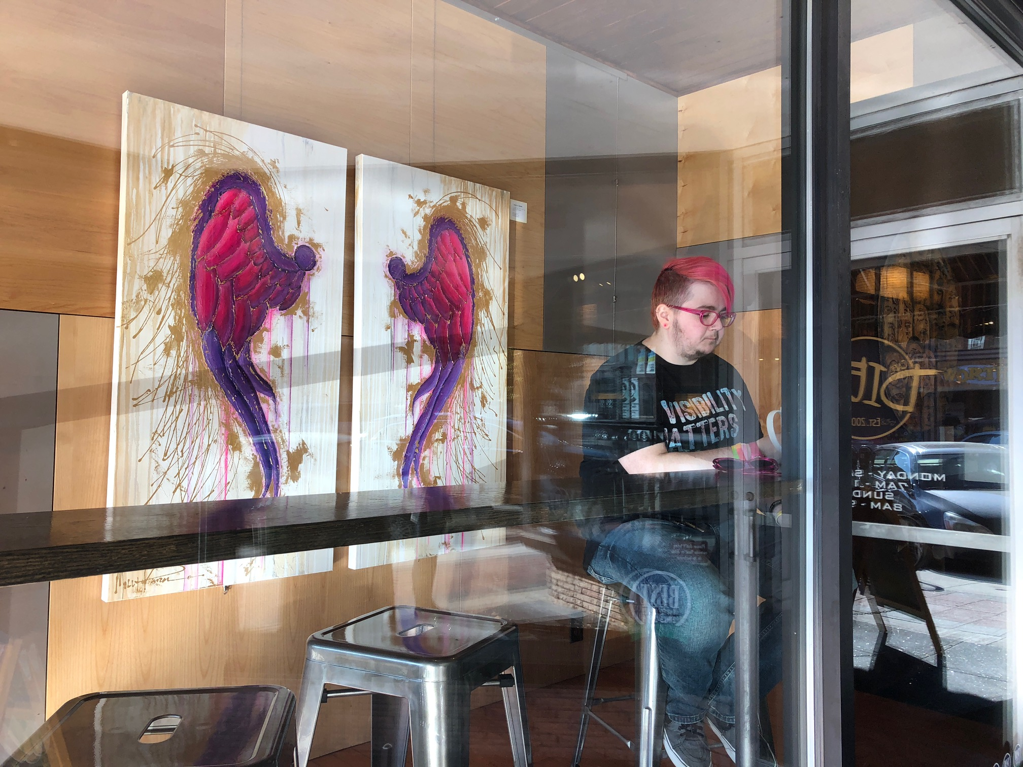 LGBTQ advocate Freddi Funnell sits at a cafe in Ames, Iowa, Oct. 27, 2018. He started a support group last year for people in central Iowa who identify as transgender or non-binary.