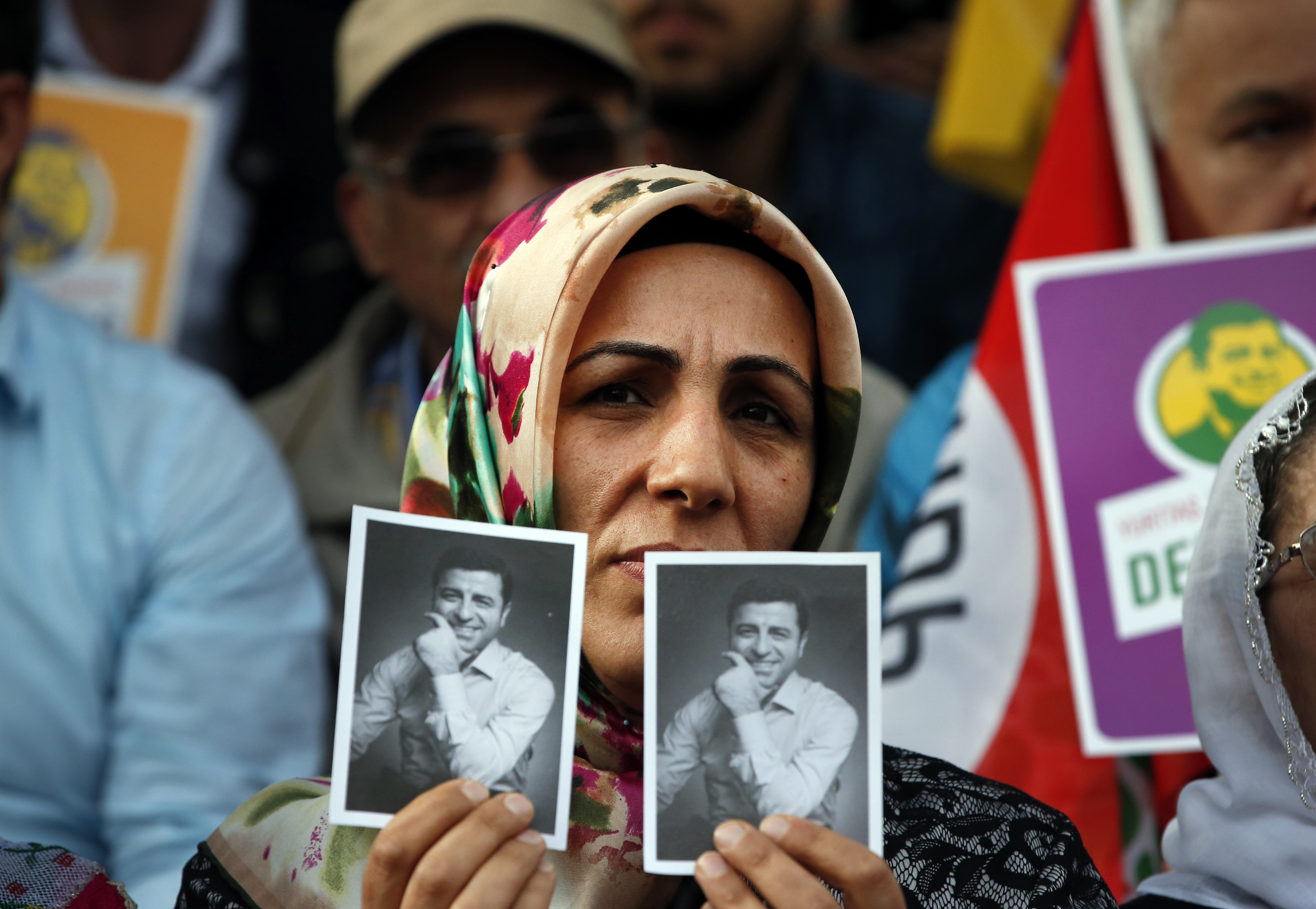 Supporters of the pro-Kurdish Peoples' Democratic Party (HDP) some holding pictures of the party's former co-leader Selahattin Demirtas, currently in prison on charges of leading a terror organisation, chant slogans during a rally announcing him as a...