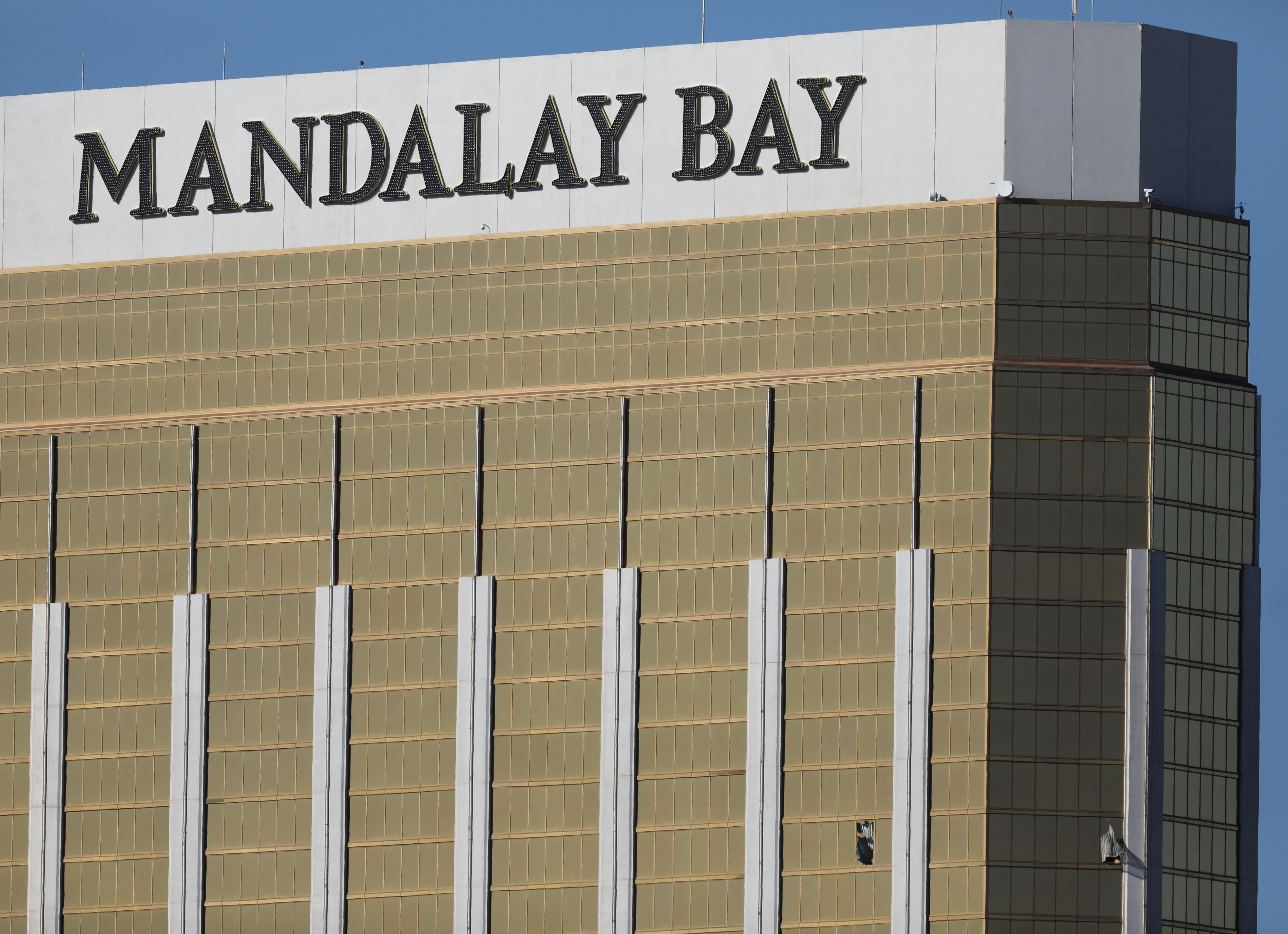 Two broken windows are seen at The Mandalay Bay Resort and Casino following a mass shooting at the Route 91 Festival in Las Vegas, Nevada, Oct. 2, 2017.
