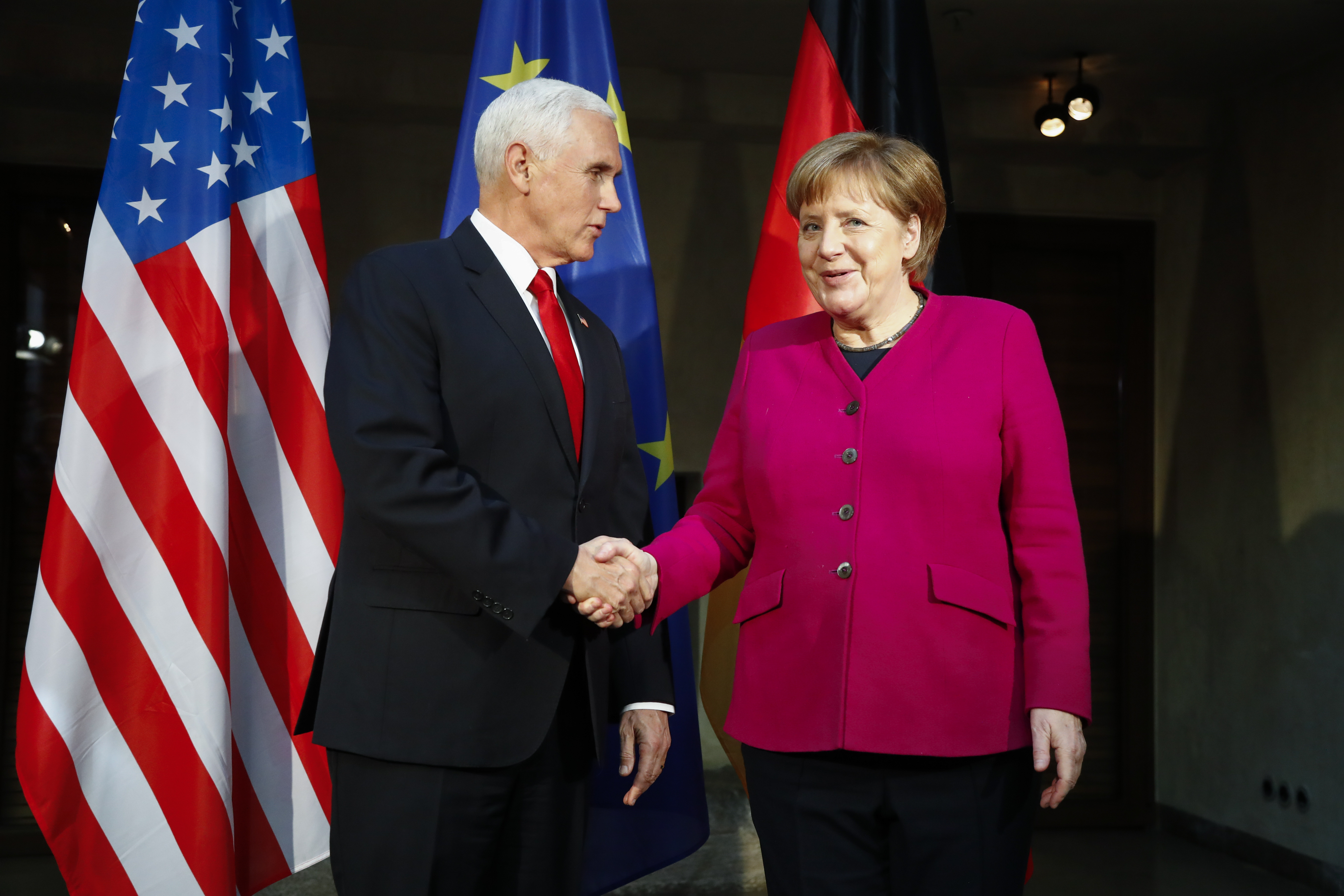 German Chancellor Angela Merkel, right, welcomes United States Vice President Mike Pence, left, for a bilateral meeting during the Munich Security Conference in Munich, Germany, Saturday, Feb. 16, 2019.