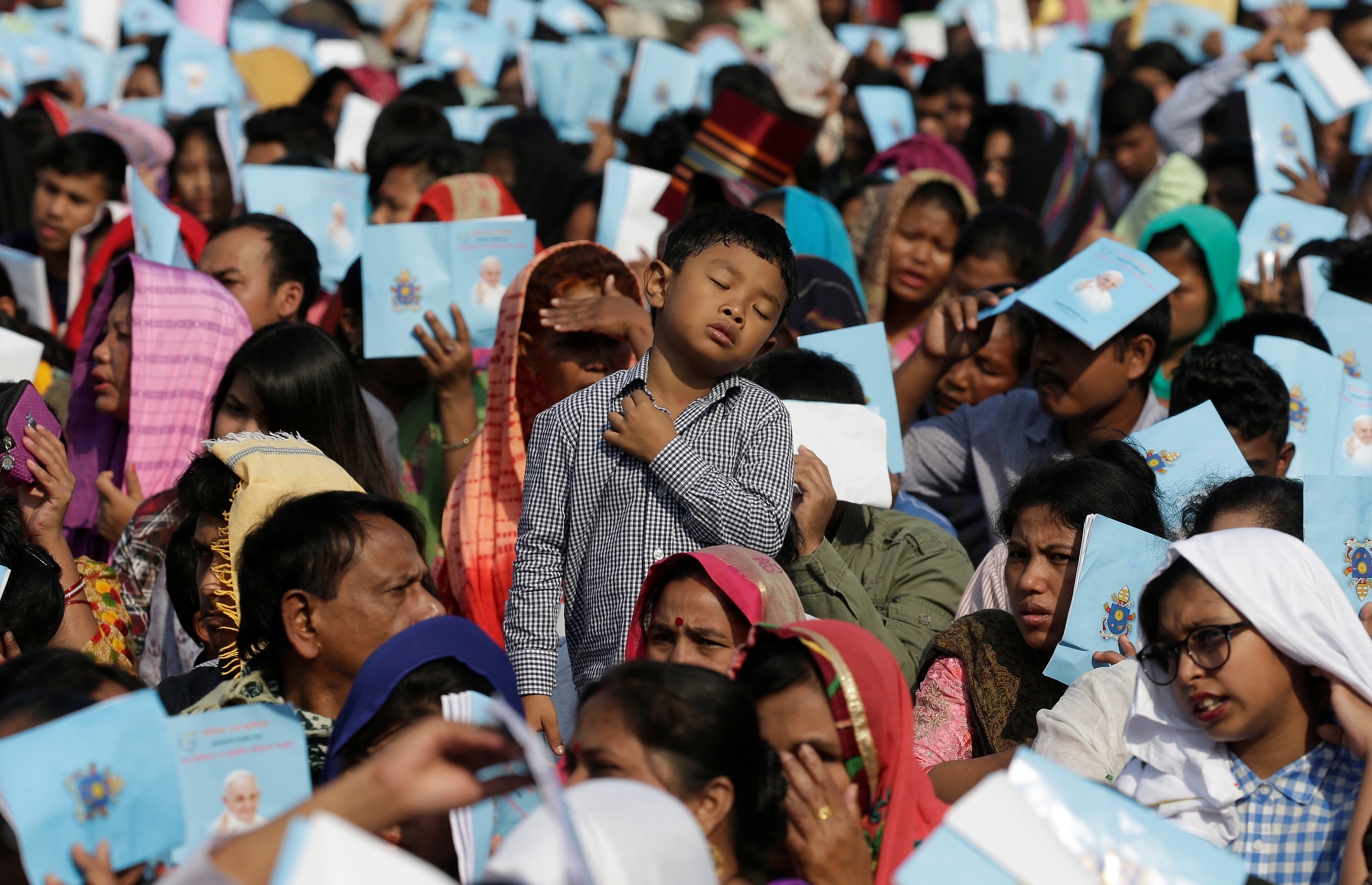 Believers attend a mass by Pope Francis in Dhaka, Bangladesh, Dec. 1, 2017.