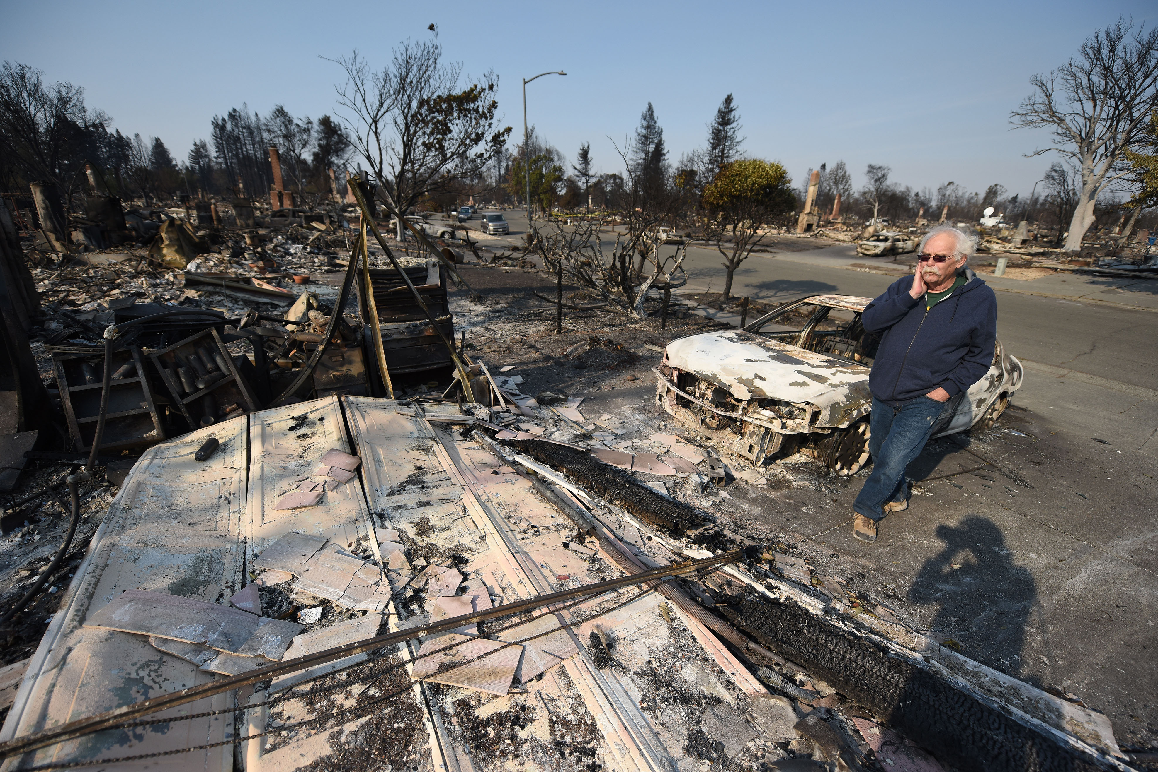 Homeowner Phil Rush reacts as he looks at the remains of his home destroyed by wildfire in Santa Rosa, Calif., Oct. 11, 2017.   Rush said he and his wife and dog escaped with only their medication and a bag of dog food when flames overtook their enti...