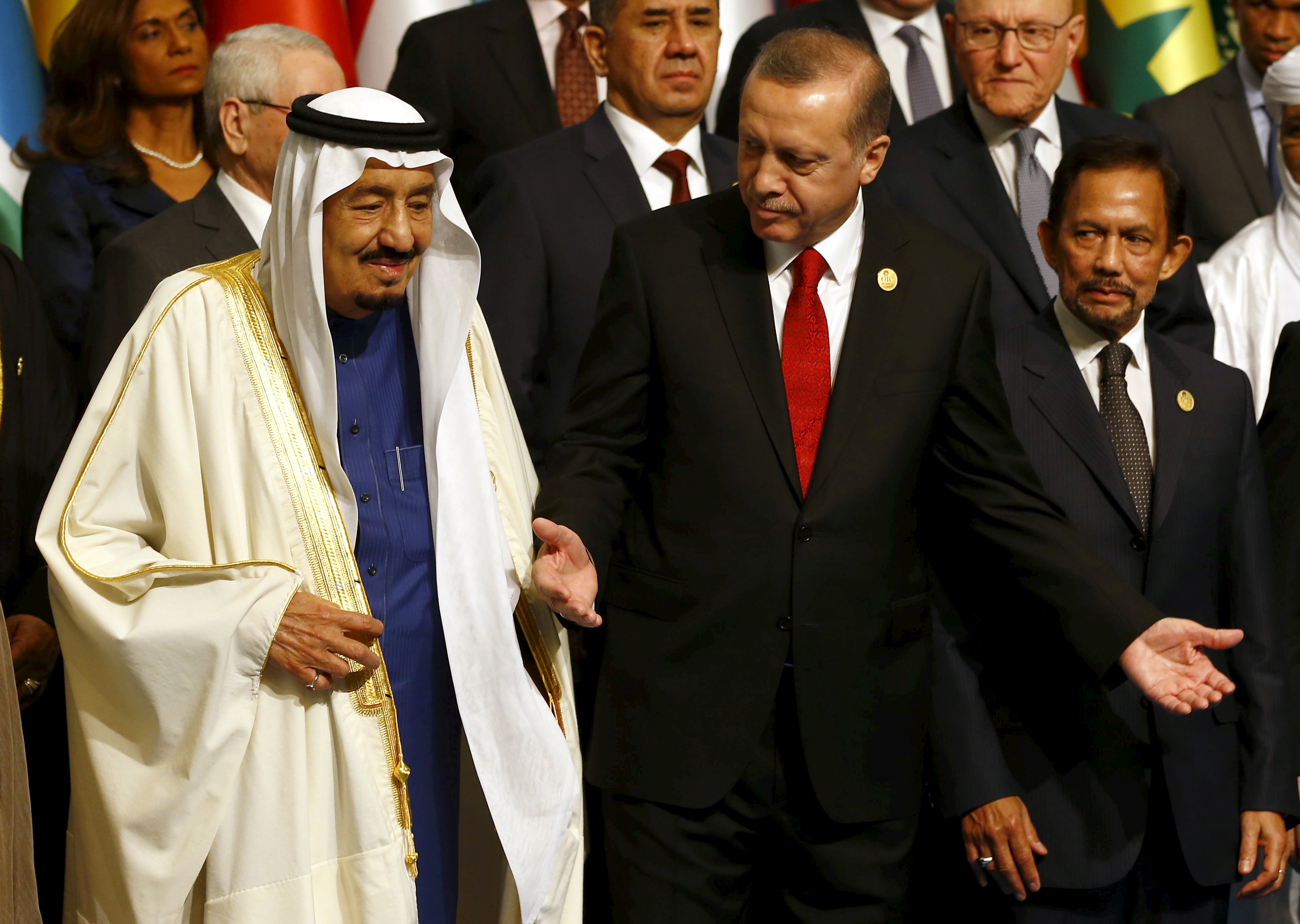 FILE - Turkish President Recep Tayyip Erdogan and King Salman of Saudi Arabia are pictured during a photo session at the Organization of Islamic Cooperation's summit in Istanbul, April 14, 2016.