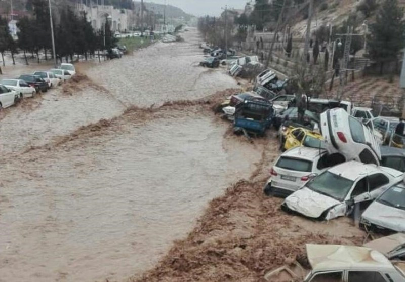 Vehicles are stacked one against another after a flash flooding In Shiraz, Iran, March 25, 2019.
