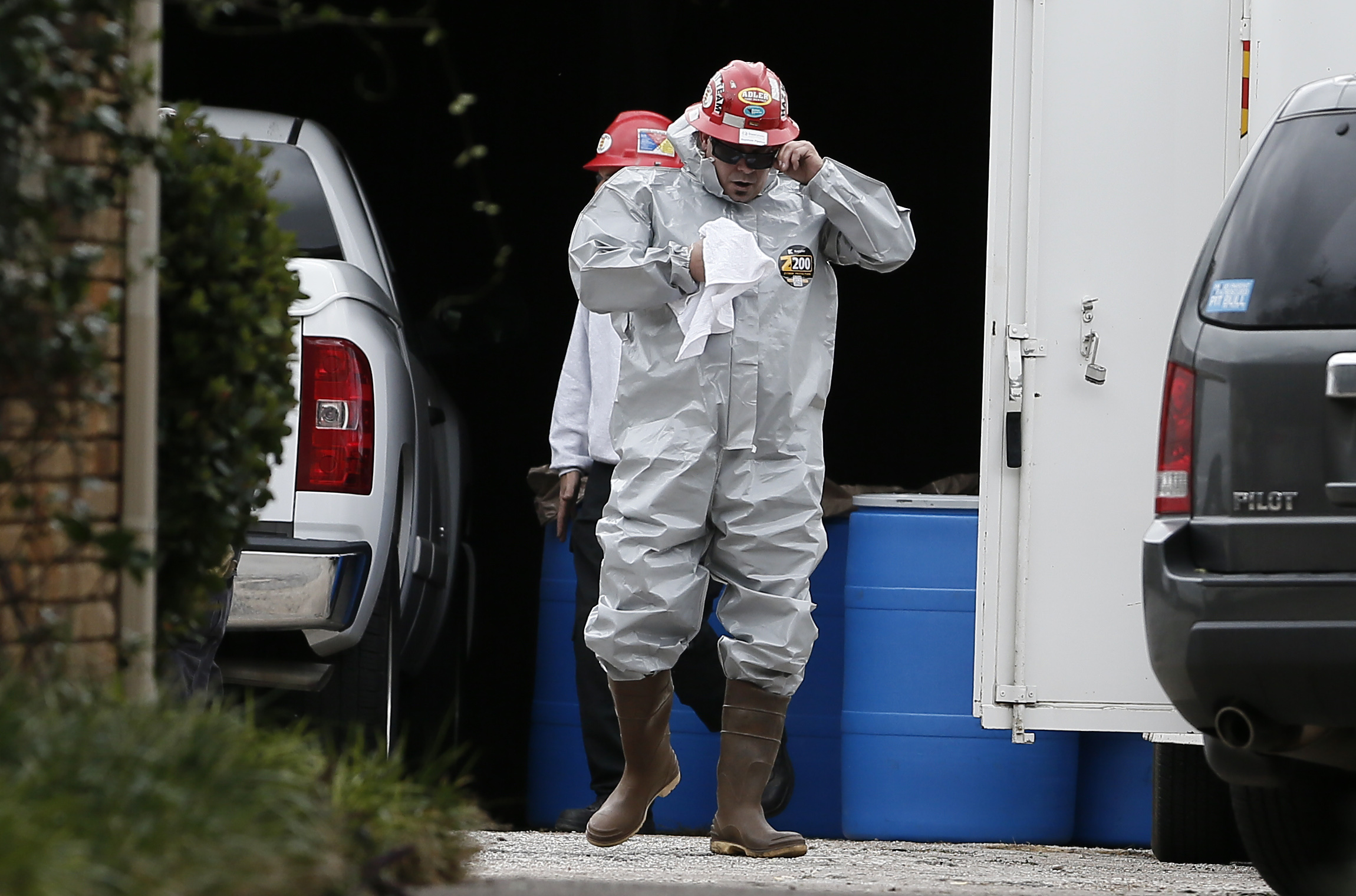 Environmental specialists disinfect the apartment of a health care worker who tested positive for Ebola in Dallas, Texas, Oct. 13, 2014.