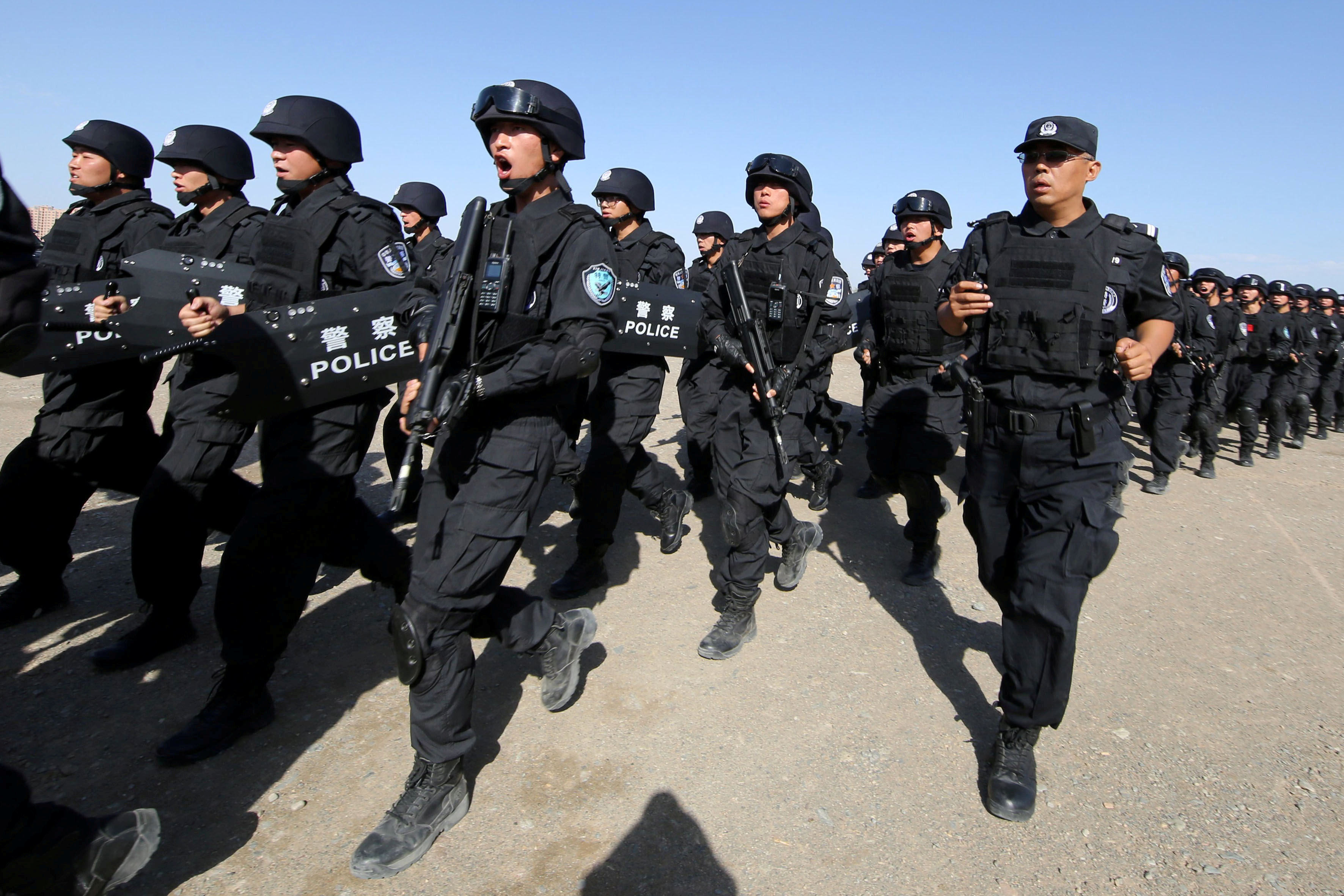 Chinese soldiers participate in an anti-terror drill in Hami, Xinjiang Uighur Autonomous Region, China, July 8, 2017.
