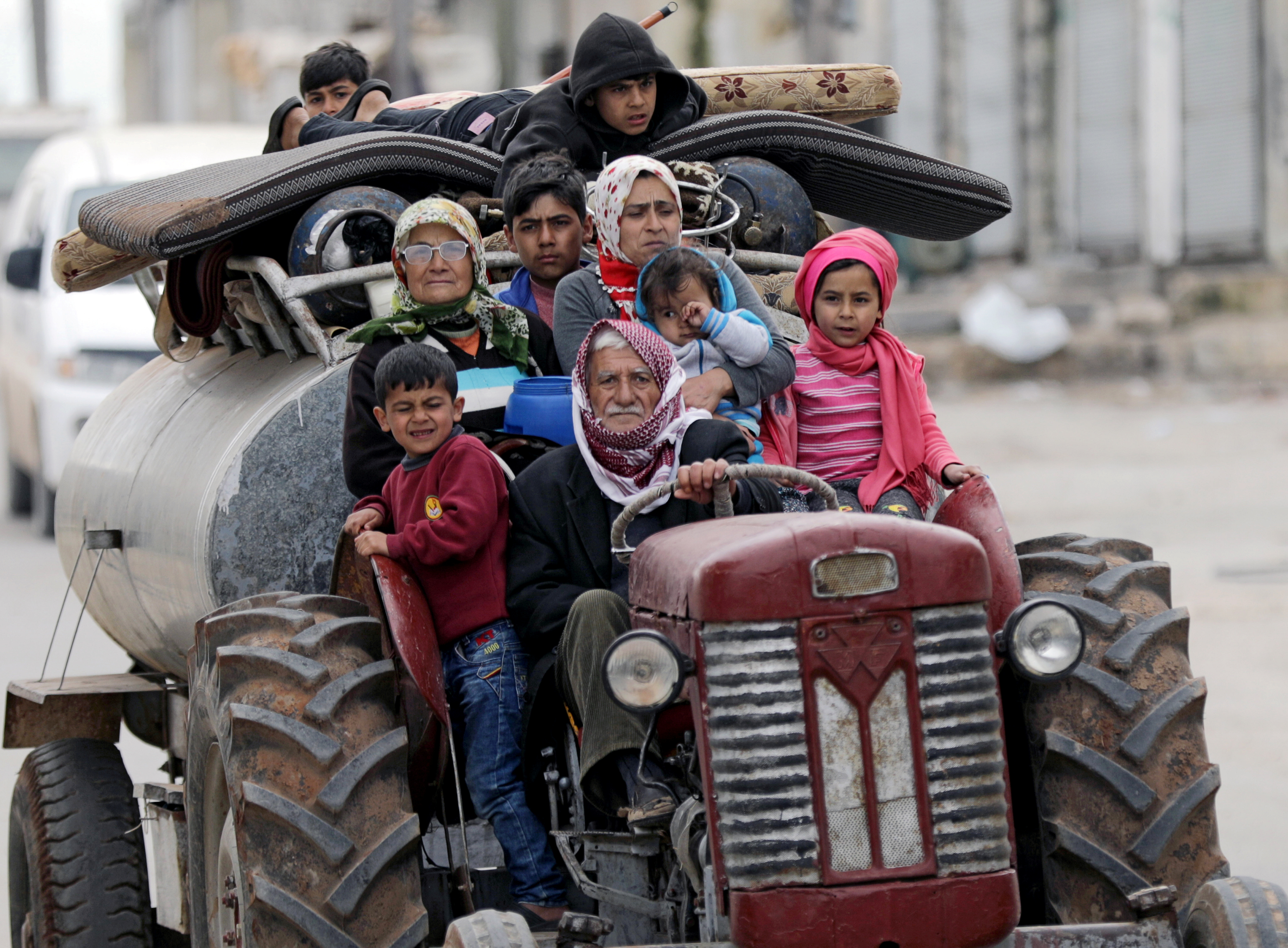 People flee after Turkish-backed Free Syrian Army fighters captured Khaldieh village in eastern Afrin, Syria March 10, 2018.