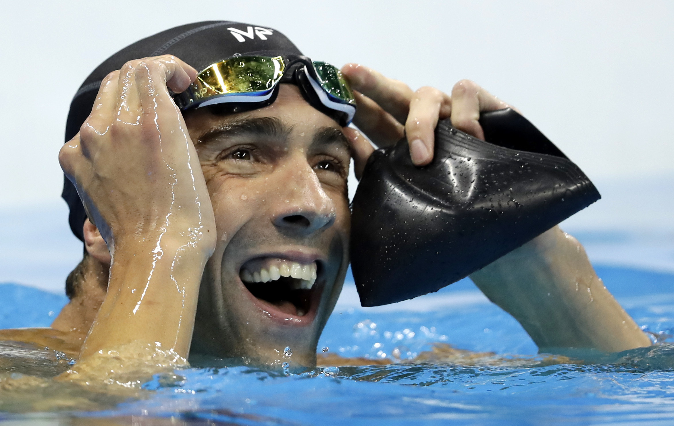 United States' Michael Phelps reacts after the men's 100-meter butterfly final during the swimming competitions at the 2016 Summer Olympics, Friday, Aug. 12, 2016, in Rio de Janeiro, Brazil.