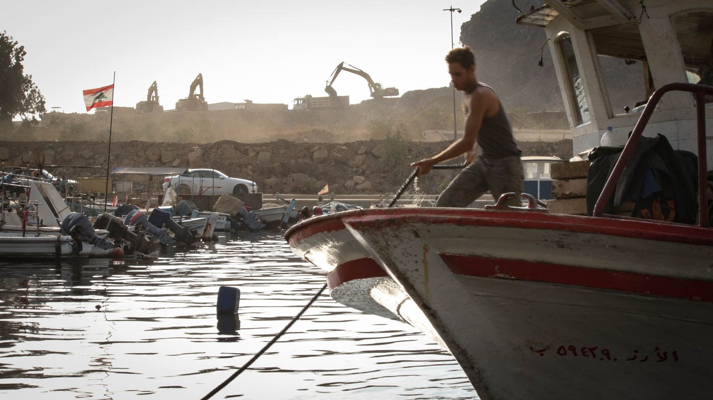 A boat arrives at port in Bourj Hammoud, a district in Beirut. It has long been overlooked by a trash mountain.