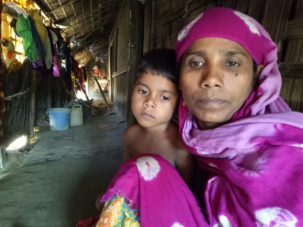 """Rohingya refugee woman Noor Ayesha and her 5-year-old daughter at a Rohingya colony in Cox's Bazar, Bangladesh. """"[During the military operation] the soldiers burnt alive my five children. They raped my two other daughters in front of me, before killi"""