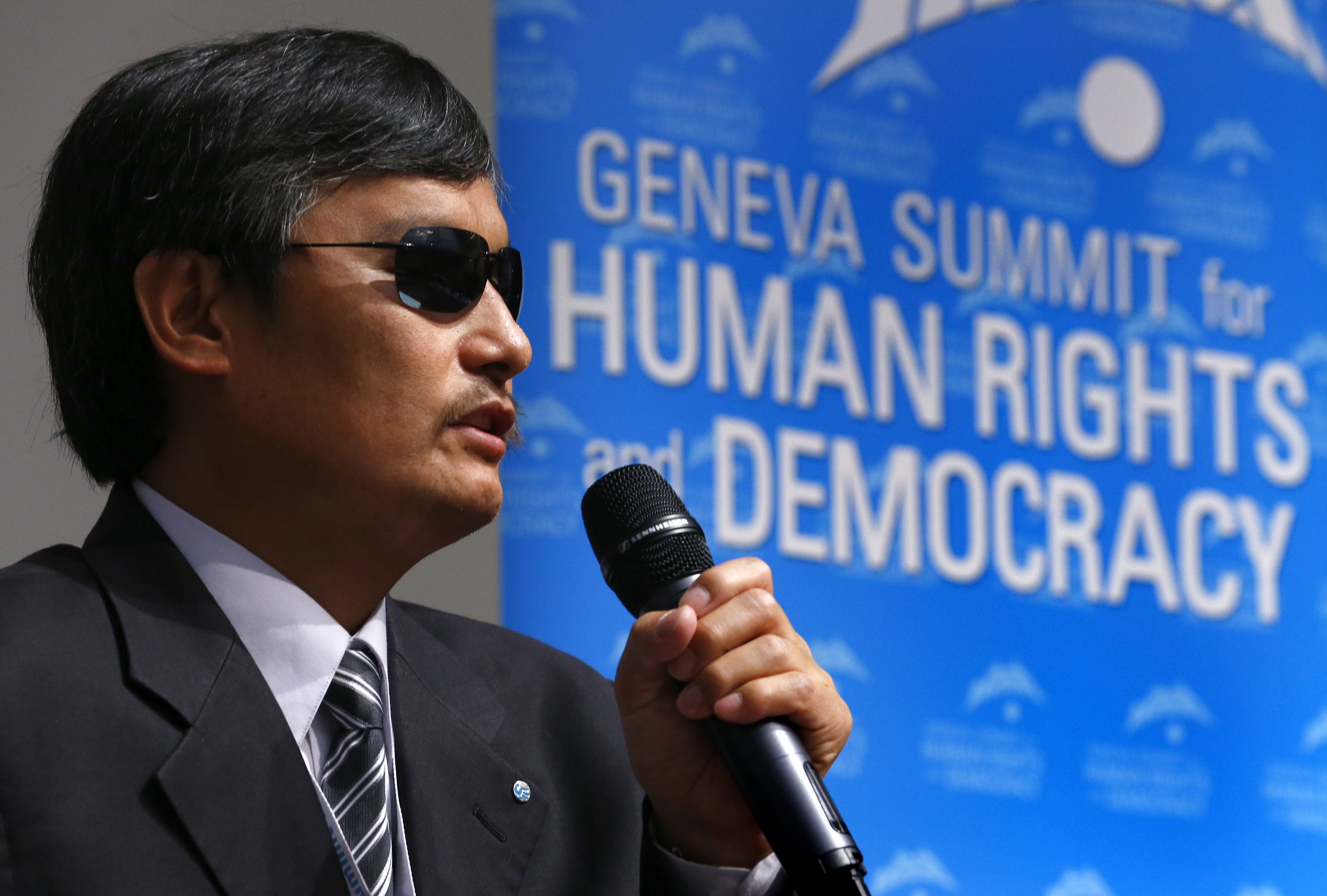 Blind Chinese dissident Chen Guangcheng addresses the sixth Geneva Summit for Human Rights and Democracy after receiving its first Courage Award, in Geneva, Feb. 25, 2014.