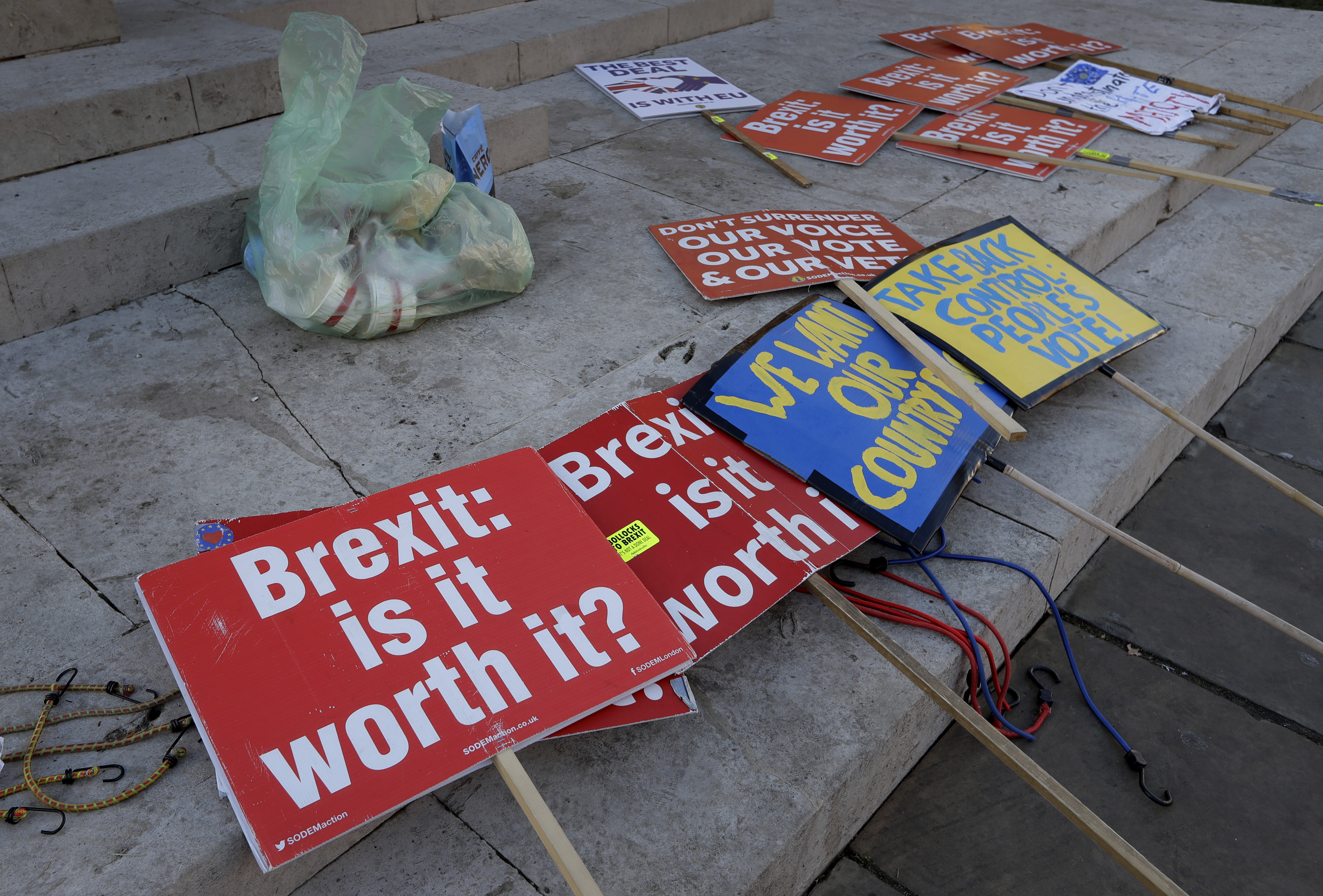 Brexit banners lie on the ground near parliament in London, Britain, Jan. 17, 2019.