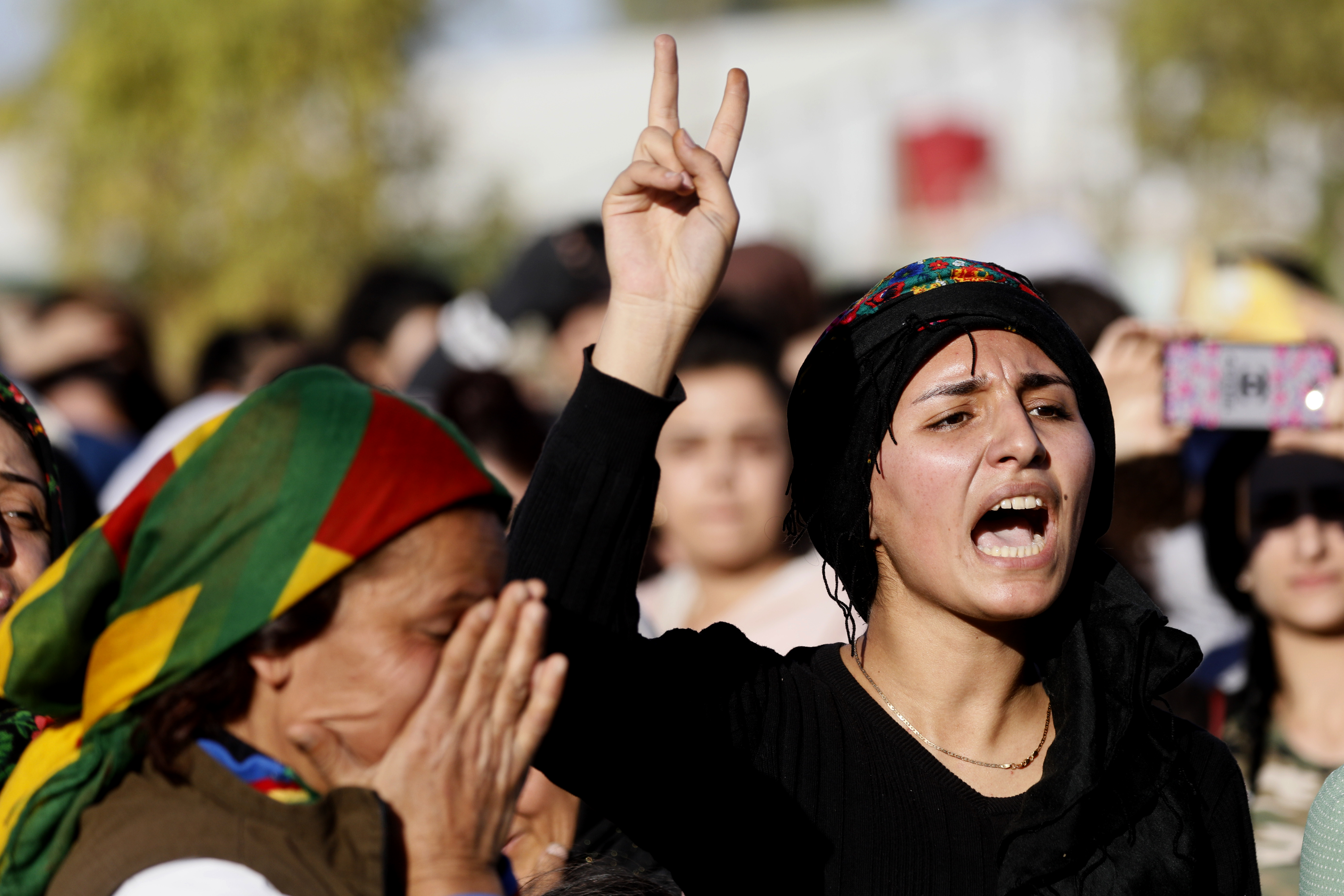 FILE - Mourners attend the funeral of a commander from the Syrian Democratic Forces, killed a day earlier in the town of Hajin during battles against the Islamic State group, in the Kurdish-controlled city of Qamishly in northeastern Syria, Oct. 29, ...