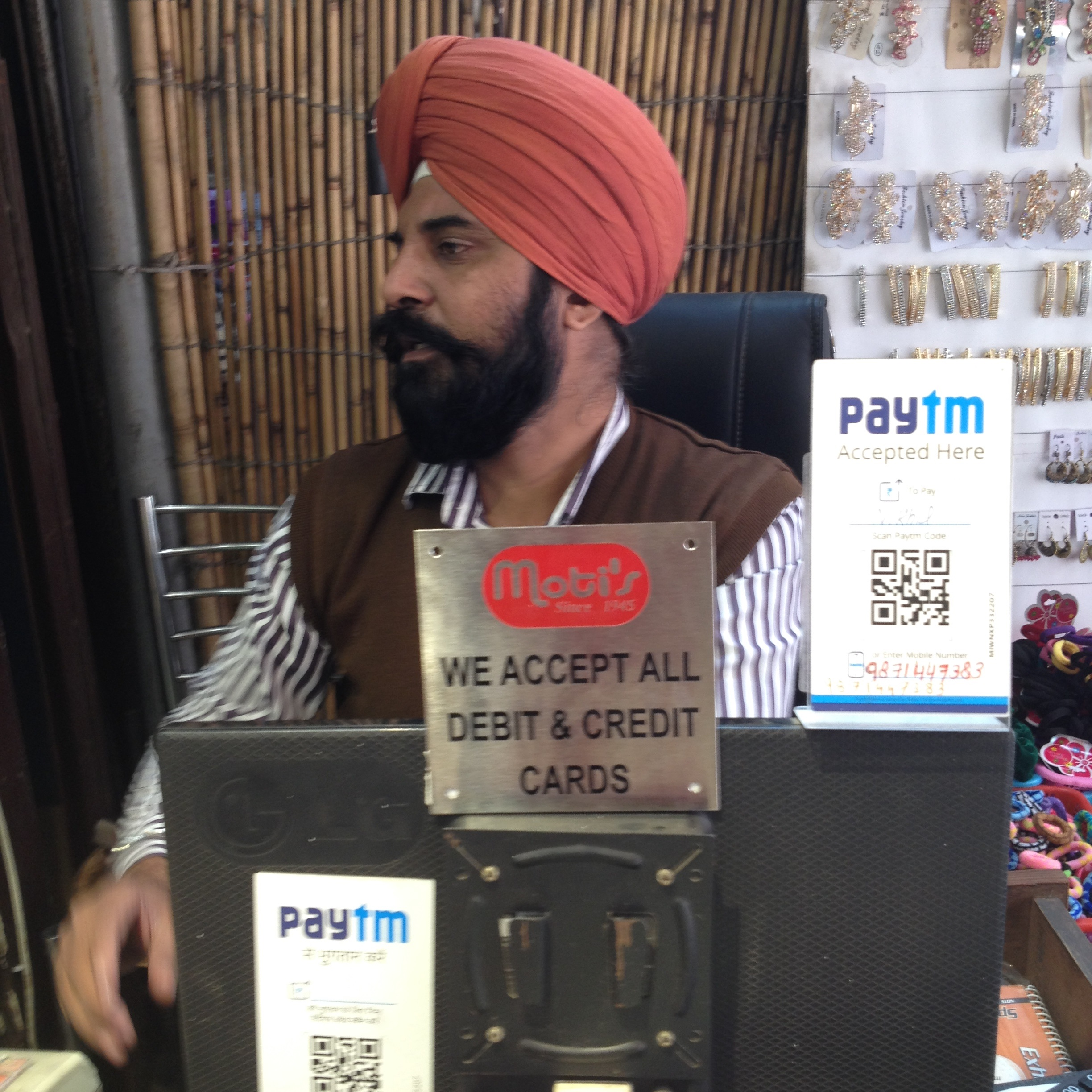 Massive cash shortages prompted shop owner Satnam Singh in New Delhi to give people the option to pay via mobile wallets. (A. Pasricha/VOA)
