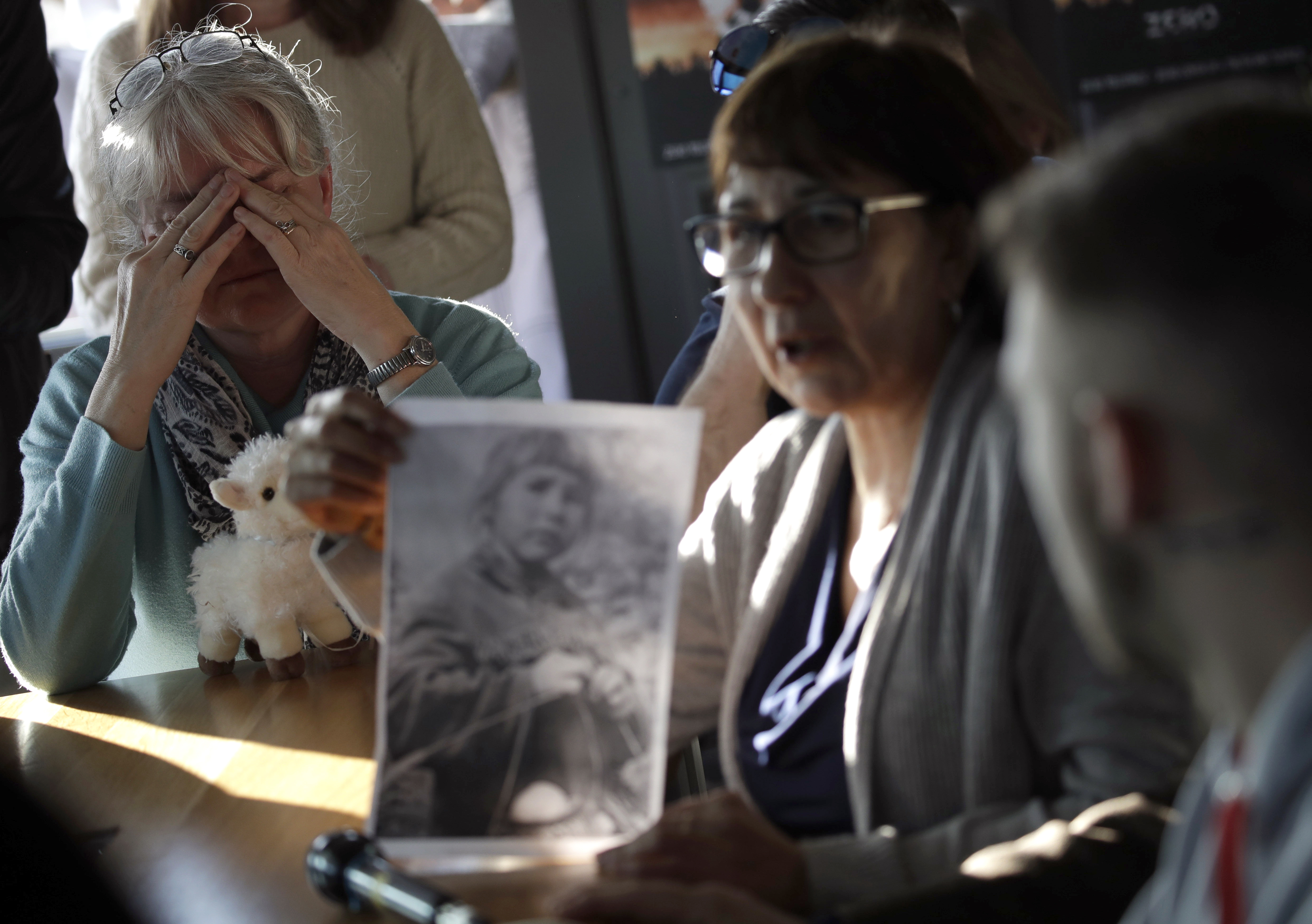 Sex abuse survivor Bernadette Howell, from Canada, left, cries as she listens to Evelyn Korkamaz, another survivor, during a press conference of members of the ECA (Ending Clergy Abuse), in Rome, Feb. 22, 2019.