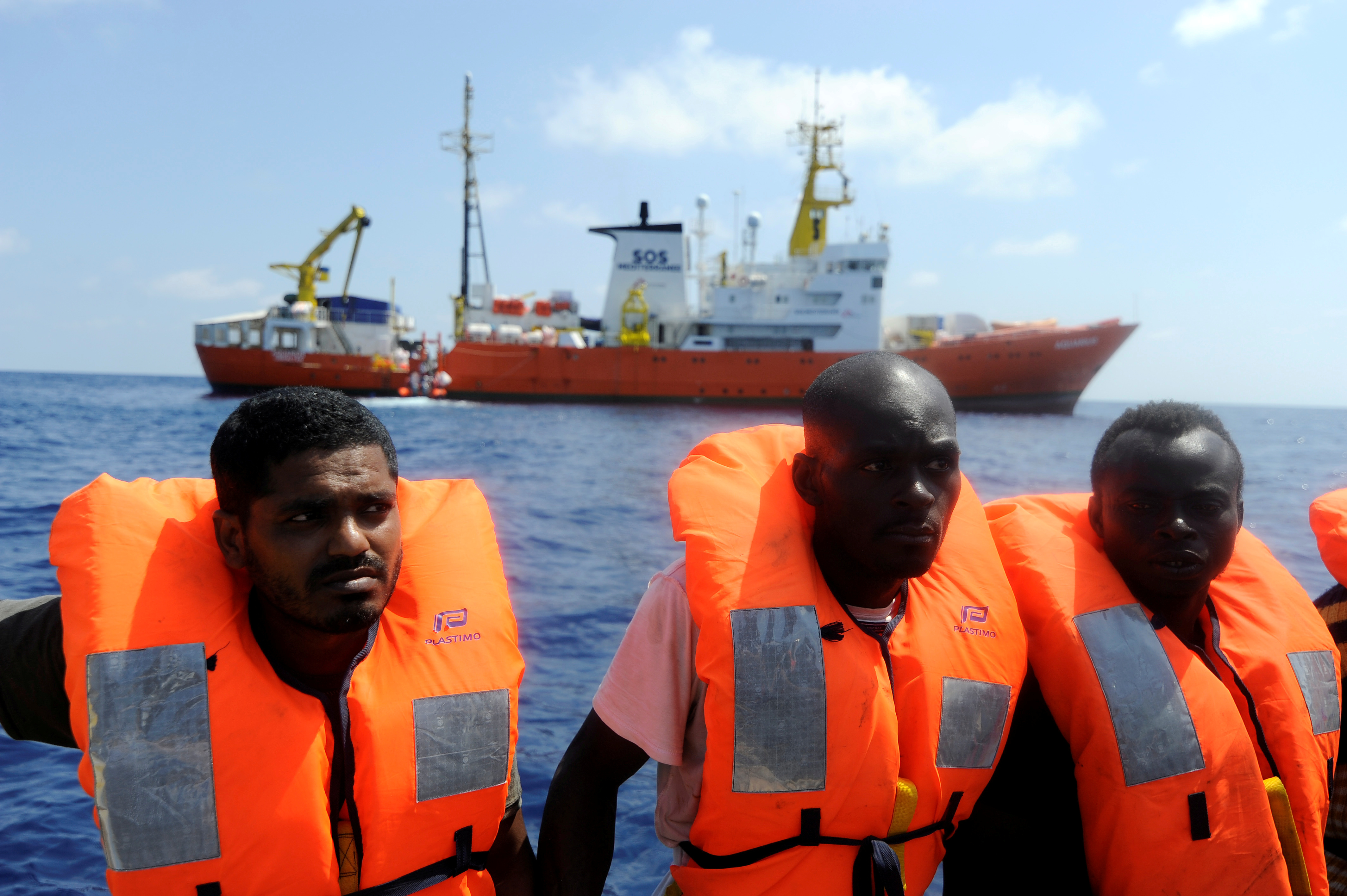 Migrants are rescued by SOS Mediterranee organization and Doctors Without Borders during a search and rescue  operation with the MV Aquarius rescue ship, off the Libyan Coast, Aug. 10, 2018.
