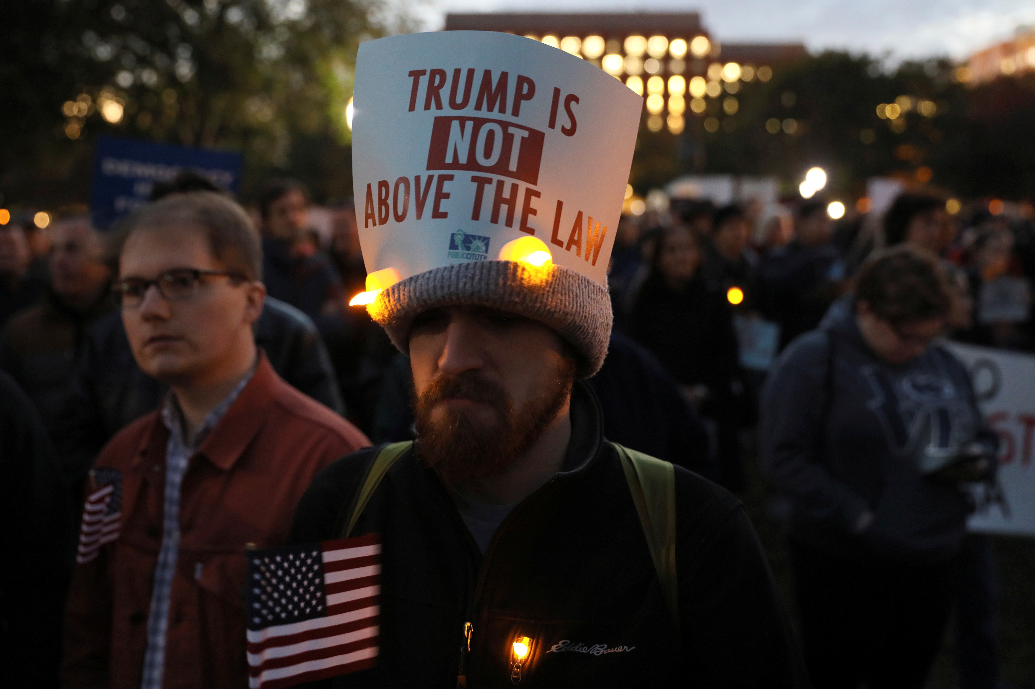 Protesters rally to demand the U.S. government to protect the investigation led by Special Counsel Robert Mueller into alleged Russian meddling in the 2016 Trump campaign, outside the White House in Washington, Nov. 8, 2018.