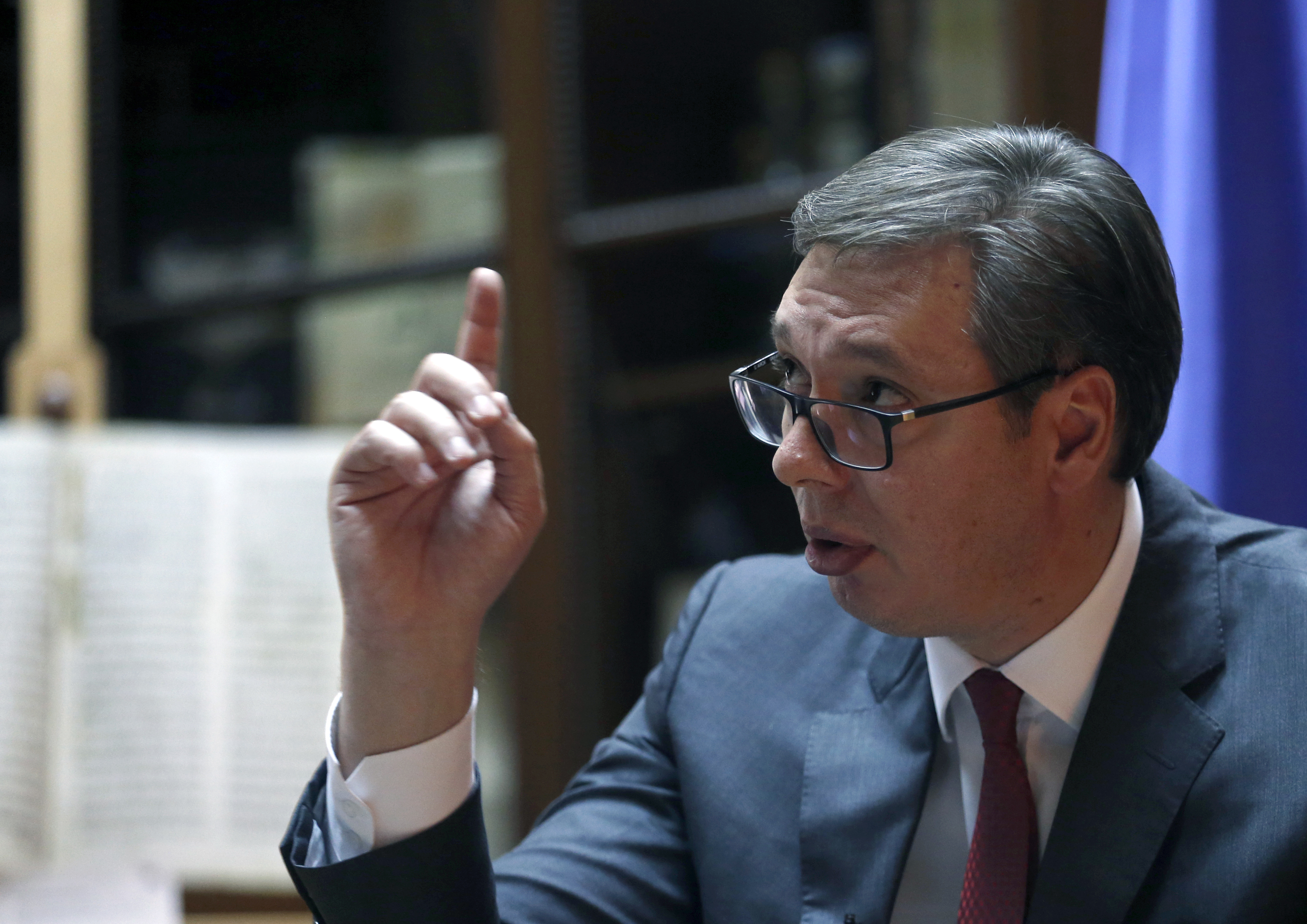 Serbian President Aleksandar Vucic speaks and gestures during an interview to The Associated Press, in Belgrade, Serbia, Oct. 13, 2017.