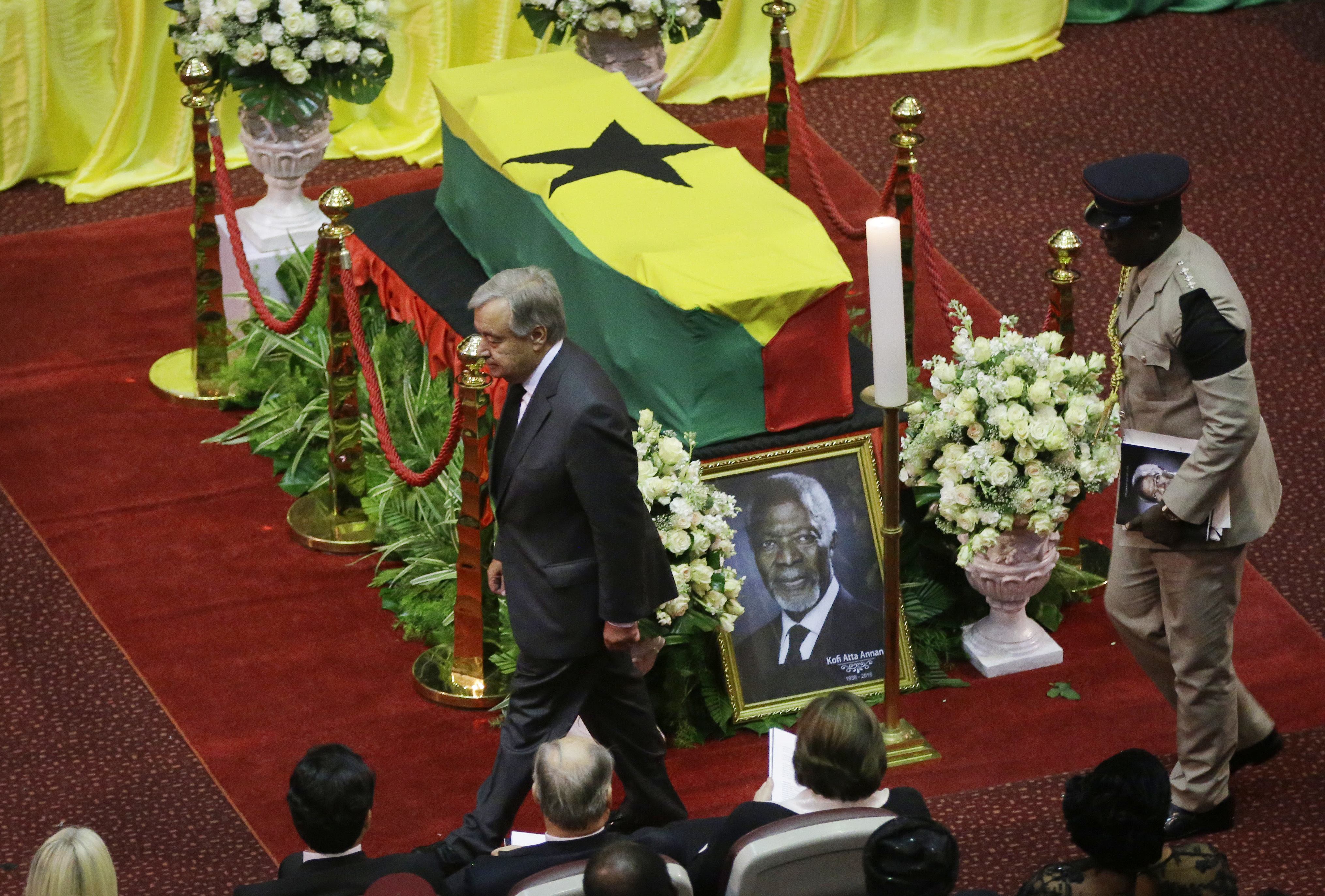 Current U.N. Secretary-General Antonio Guterres, left, pays his respects by the coffin of former U.N. Secretary-General Kofi Annan, draped with the Ghana flag, during a state funeral at the Accra International Conference Center in Ghana Thursday, Sep...
