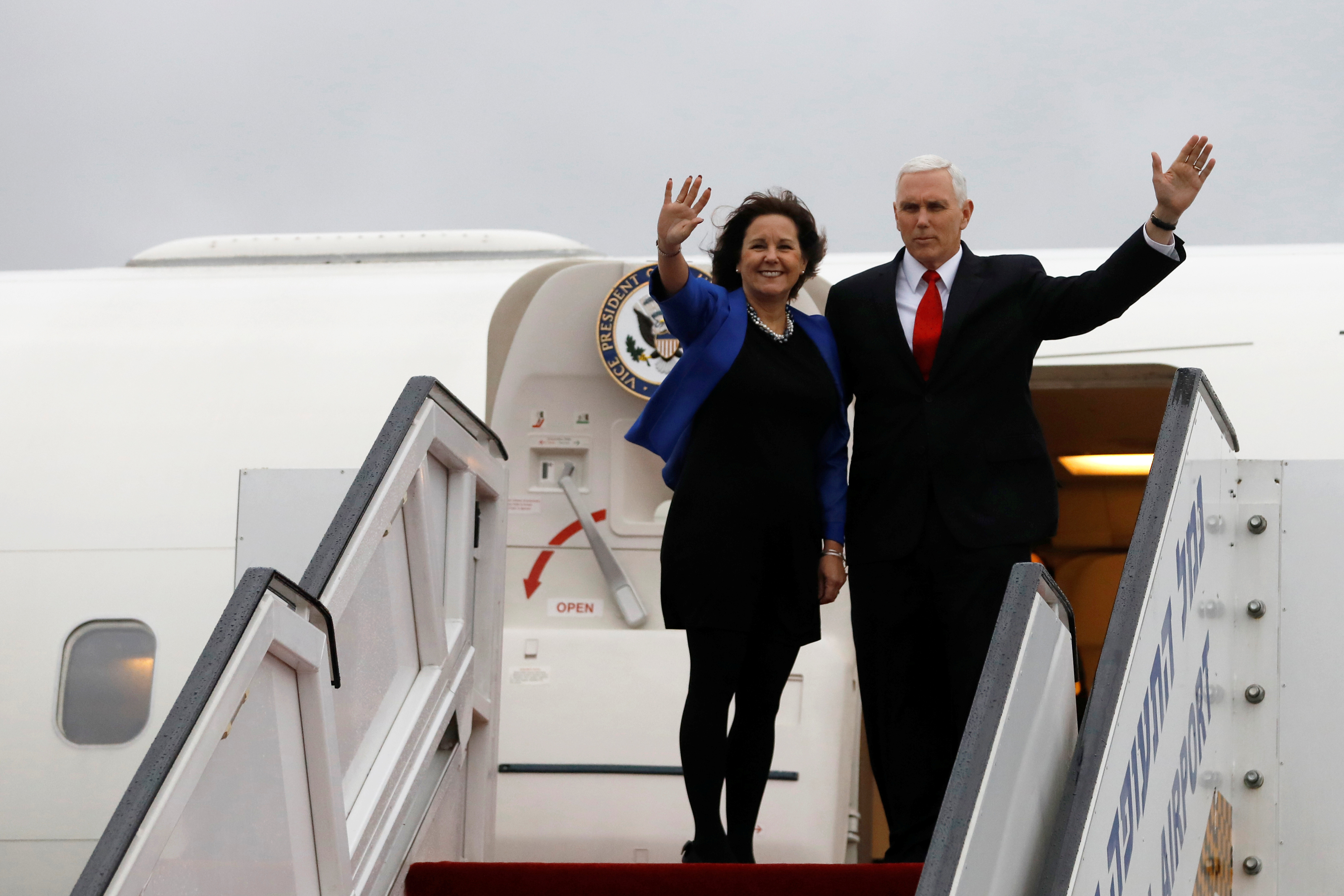 FILE - U.S. Vice President Mike Pence and his wife, Karen, wave as they prepare to depart Ben Gurion International Airport, near Tel Aviv, Israel, Jan. 23, 2018. The Pences leave Monday for a trip to Northeast Asia, including a stop at the Pyeongchan...