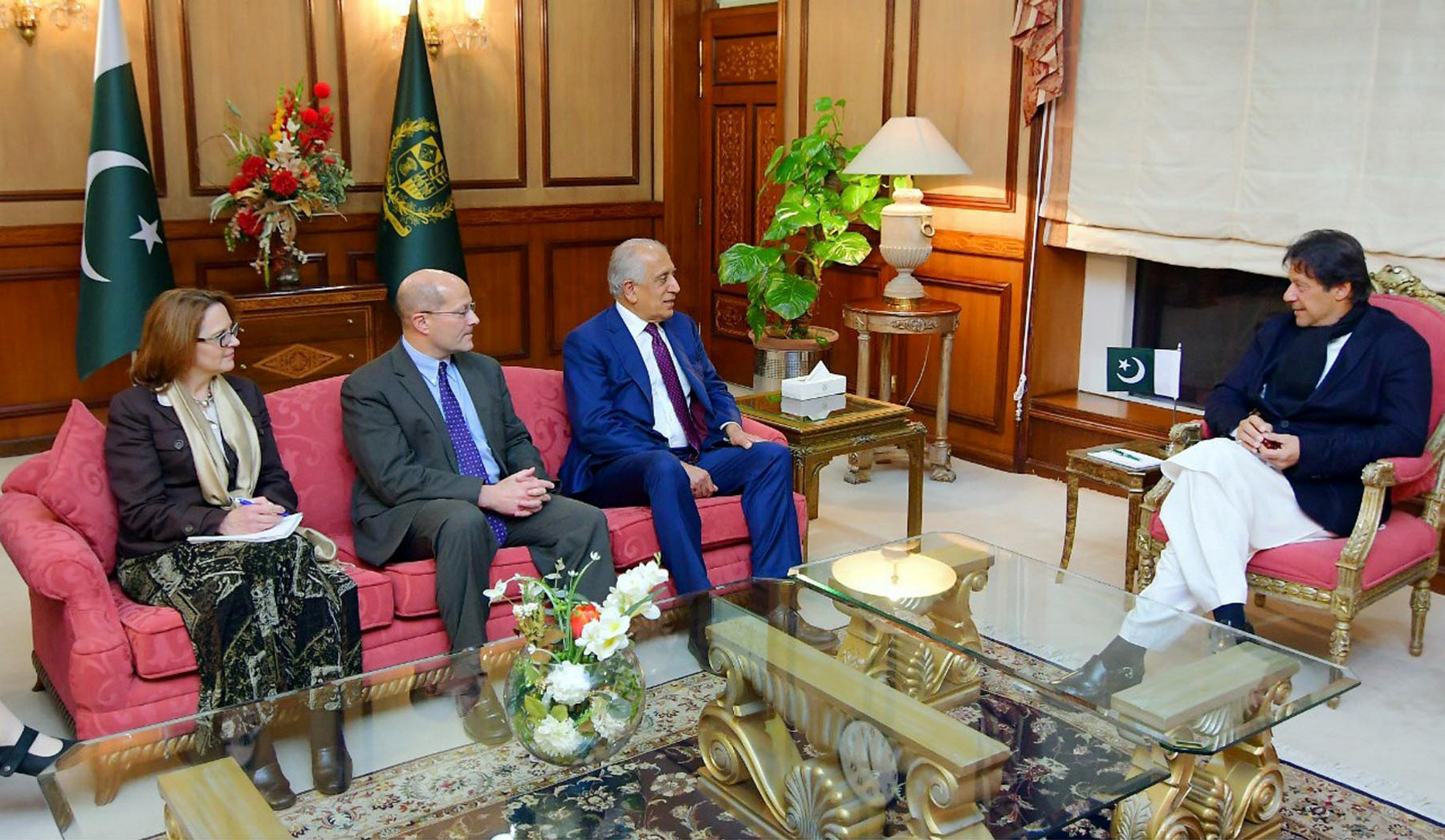 Pakistani Prime Minister Imran Khan (R) speaks with U.S. special envoy Zalmay Khalilzad (3rd L) during a meeting at the Prime Minister's office in Islamabad, Pakistan, in this handout photo released Jan. 18, 2018.
