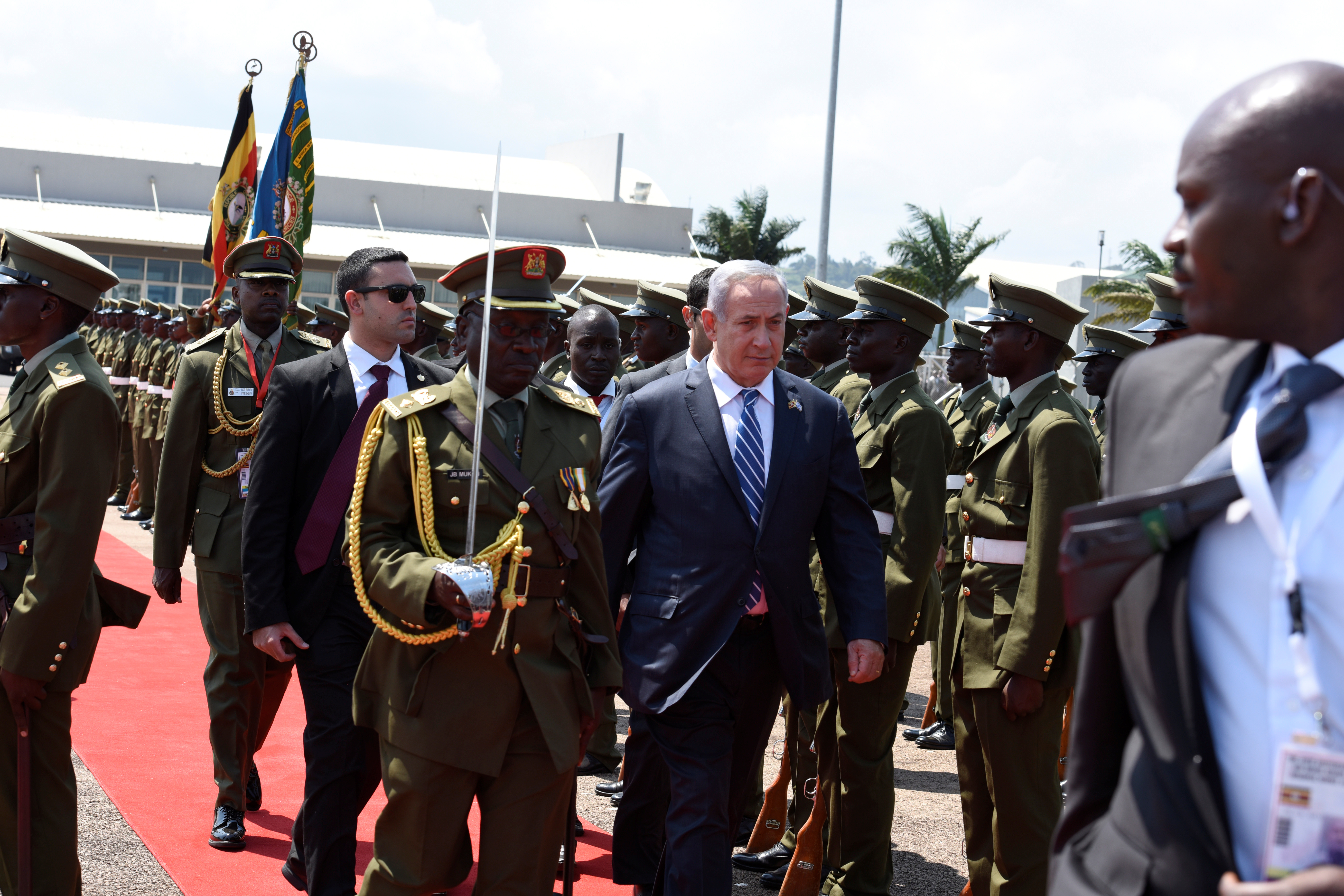 Israeli Prime Minister Benjamin Netanyahu (C) inspects a guard of honor after arriving at the Entebbe airport in Uganda, July 4, 2016.