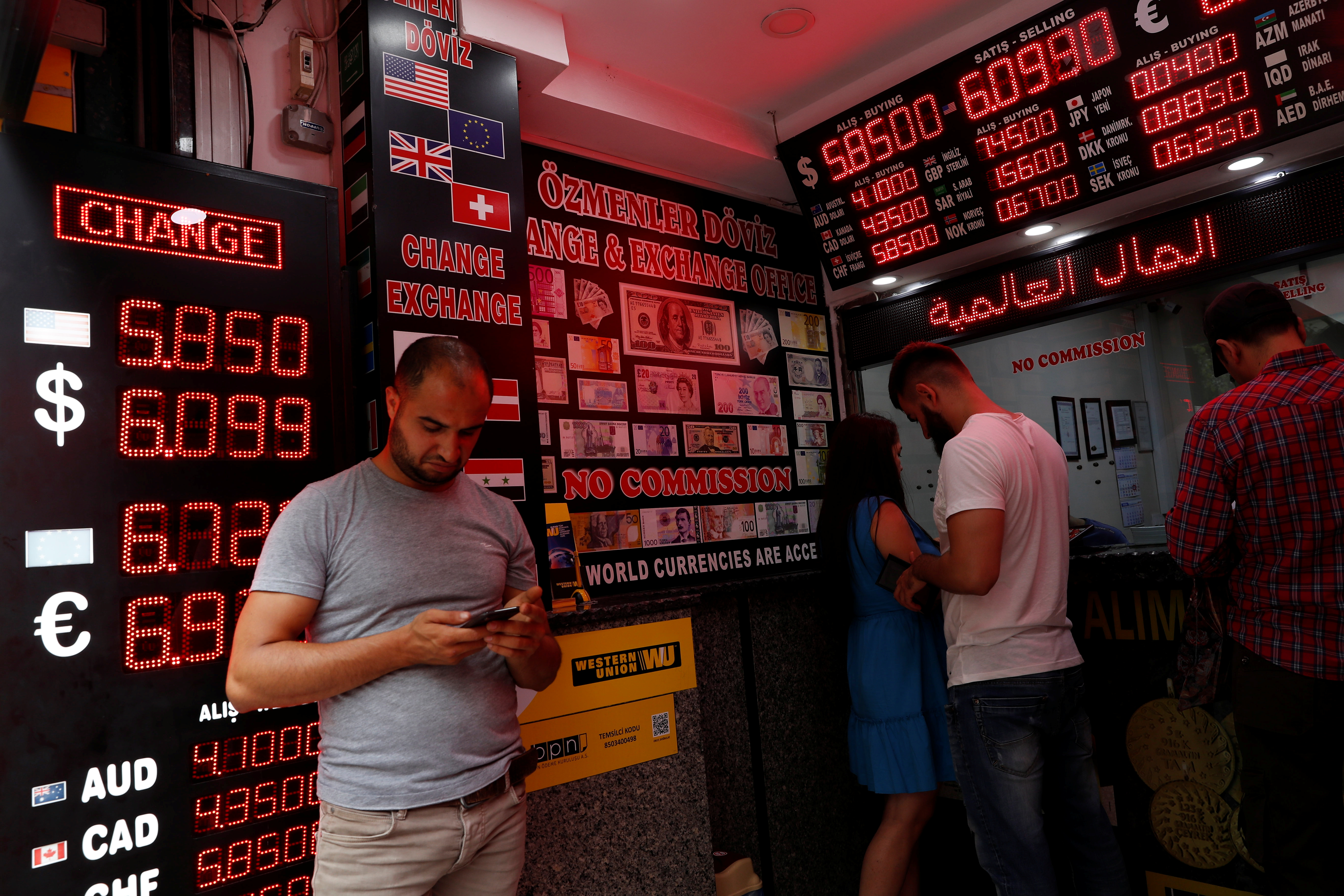 People change money at a currency exchange office in Istanbul, Turkey, Aug. 17, 2018.