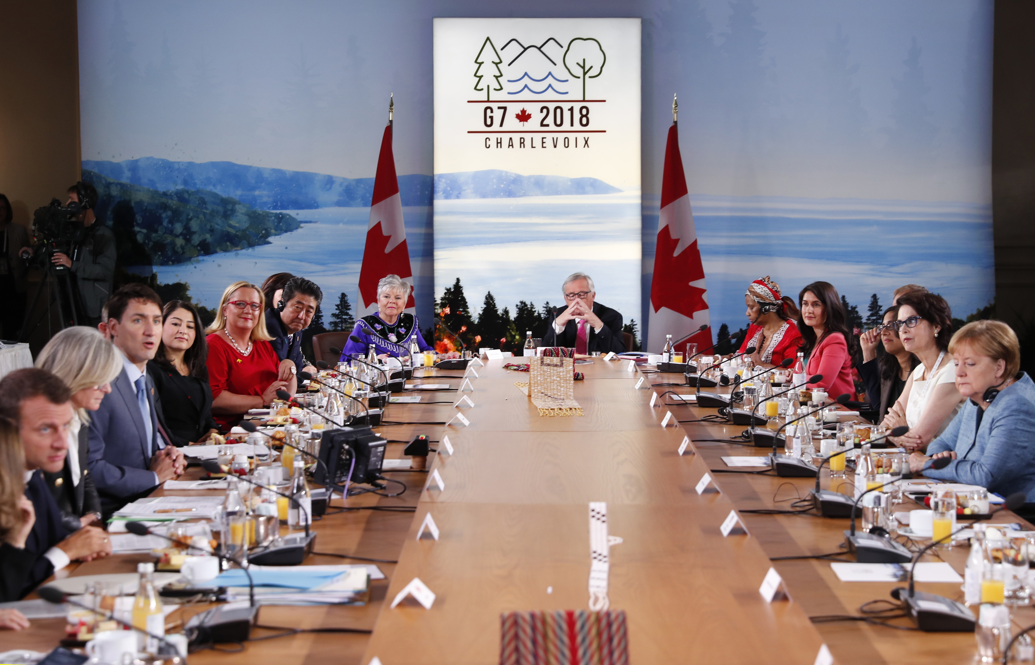 Canada's Prime Minister Justin Trudeau speaks as France's President Emmanuel Macron, Japan's Prime Minister Shinzo Abe, Germany's Chancellor Angela Merkel and other attendees look on at a G-7 and Gender Equality Advisory Council meeting as part of a ...