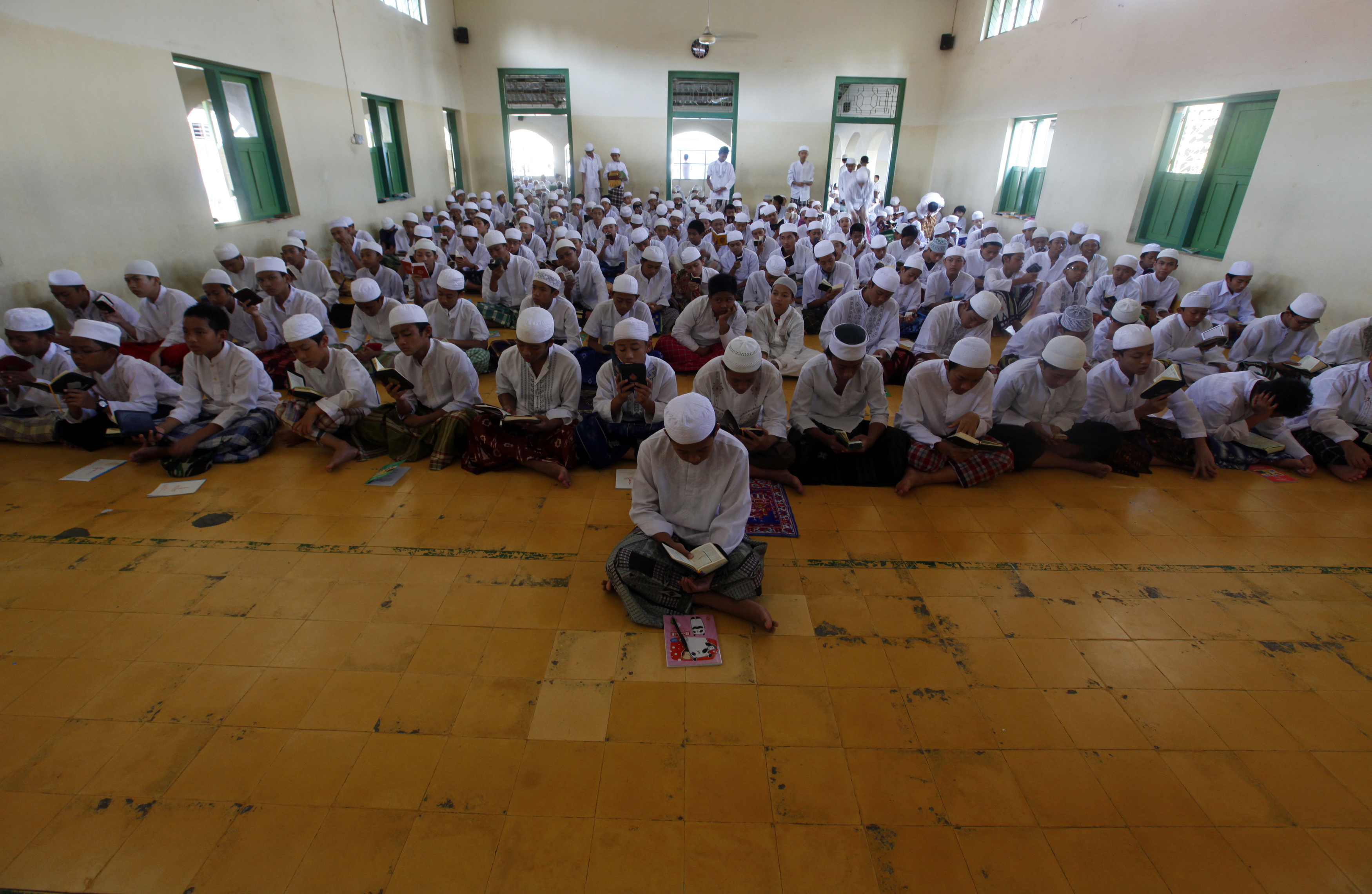 FILE - Students pray during the first day of the holy month of Ramadan at Al-Mukmin Islamic boarding school in Solo, in Indonesia's Central Java province, August 1, 2011.