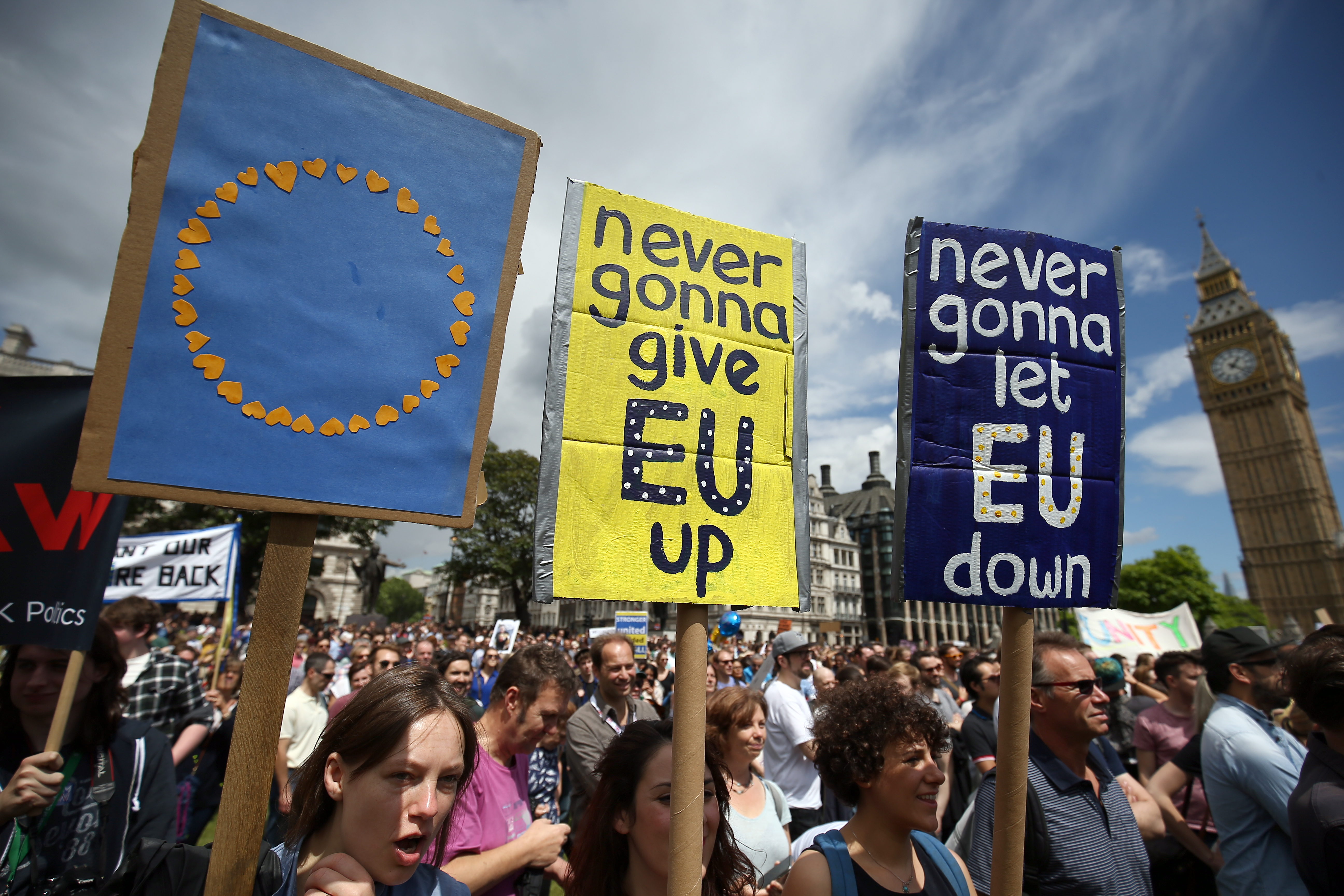 Protestors hold banners in Parliament Square during a 'March for Europe' demonstration against Britain's decision to leave the European Union, central London, Britain, July 2, 2016.