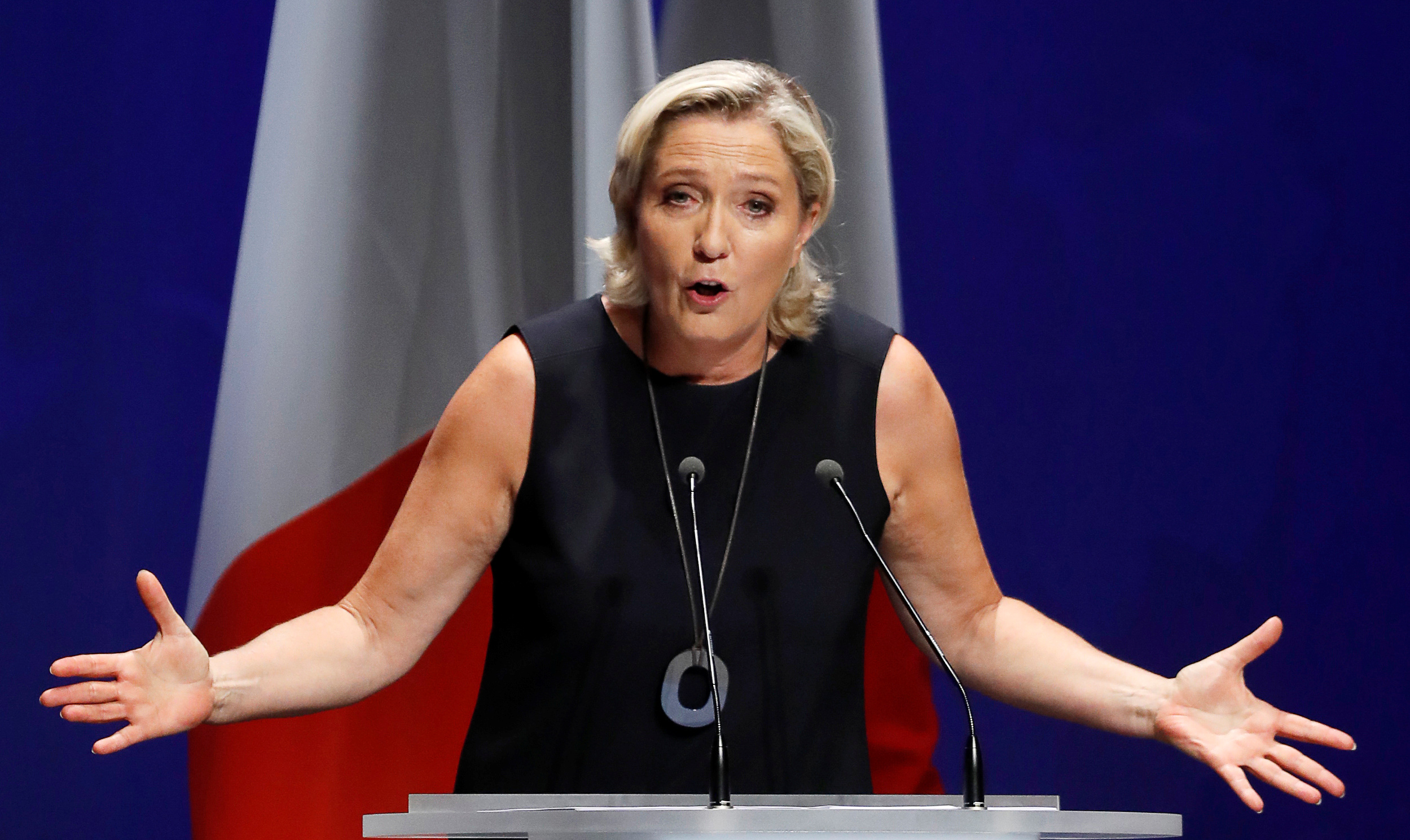 "French far-right National Rally (Rassemblement National) party leader Marine Le Pen delivers her comeback speech in Frejus, France, Sept. 16, 2018. The backdrop reads ""Nations will save Europe""."