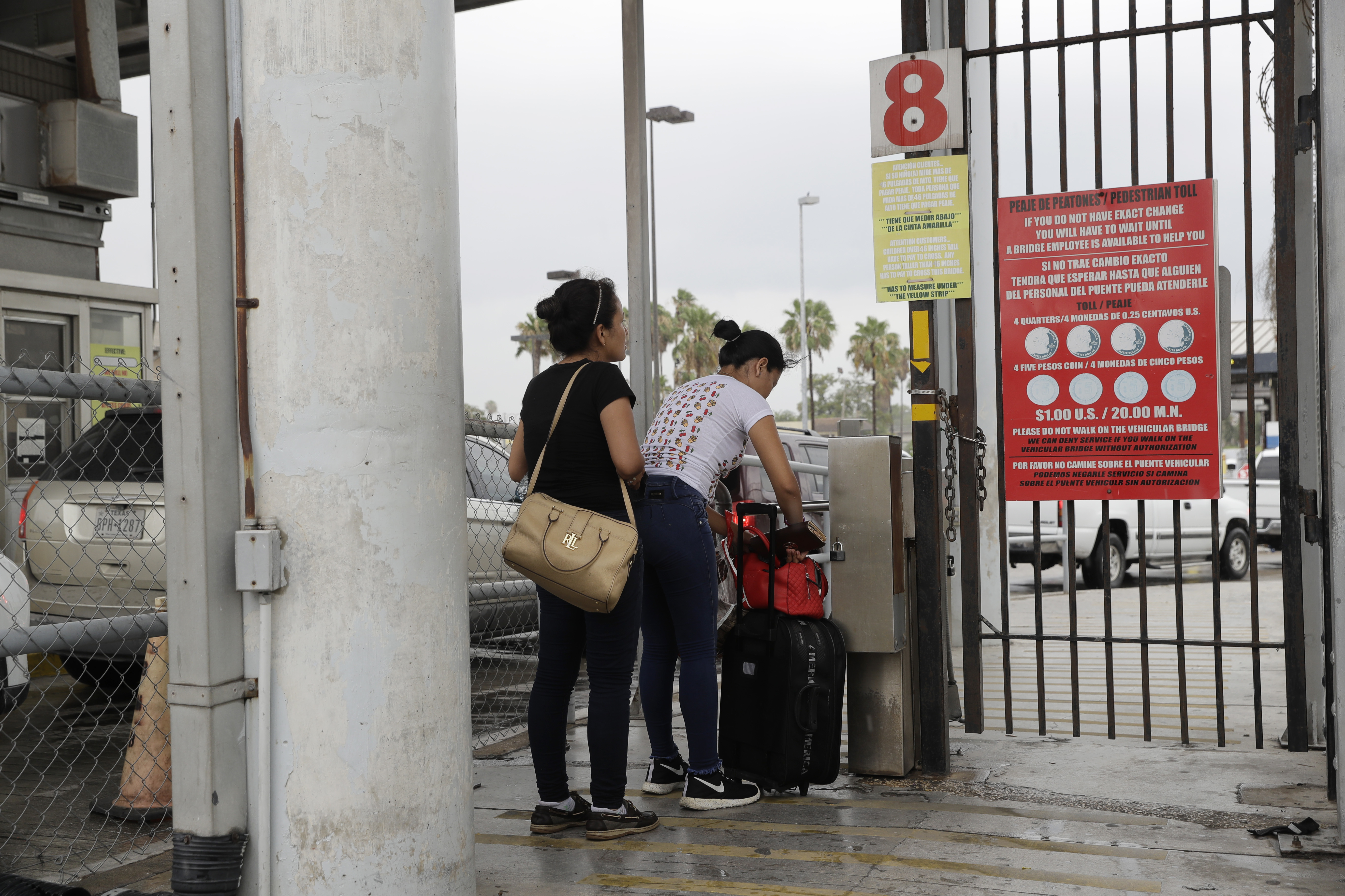 Josseline Garcia, 20, and Jennifer Garcia, 24, sisters from Guatemala seeking asylum, cross a bridge to a port of entry in to the United States from Matamoros, Mexico, June 20, 2018, in Brownsville, Texas.