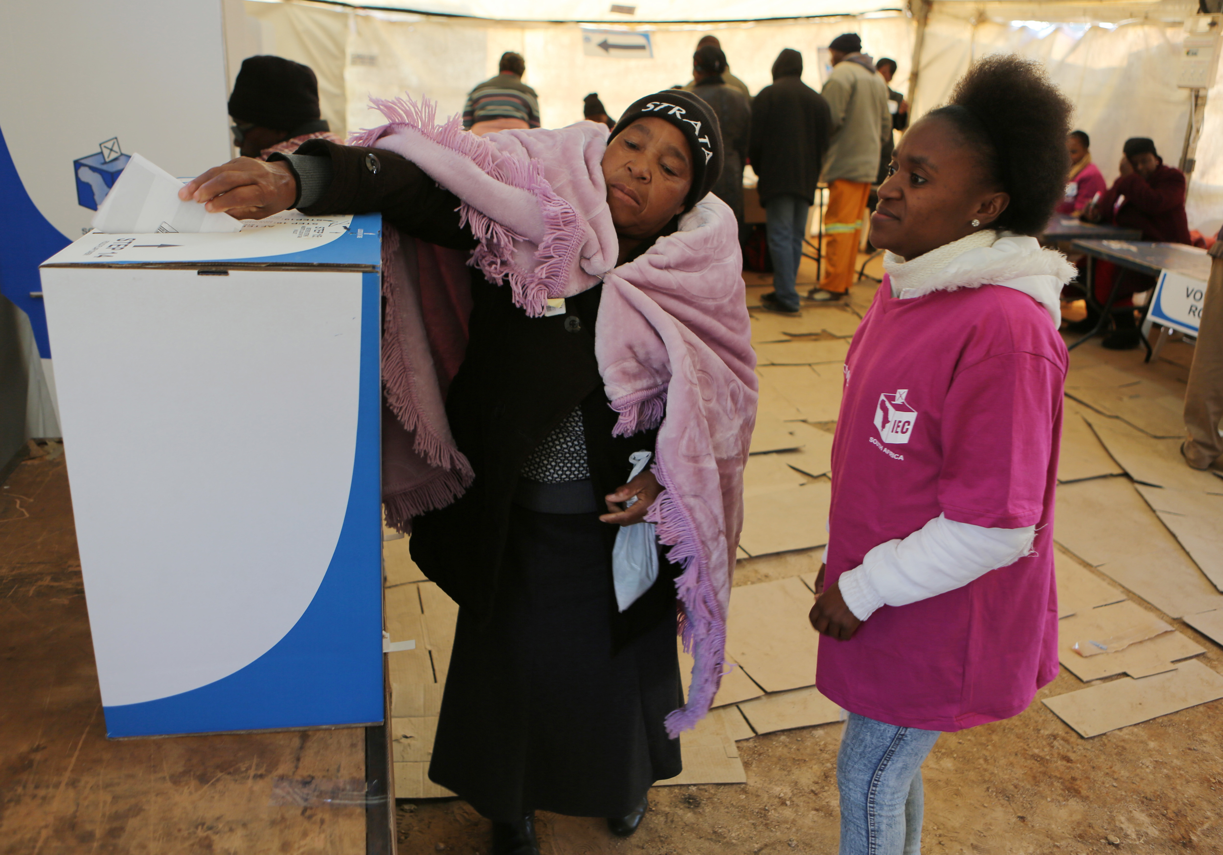 A woman casts her vote at a polling station in Soweto, South Africa, Aug. 3, 2016. South Africans were voting in municipal elections in which the ruling African National Congress seeks to retain control of key metropolitan areas despite a vigorous ch...