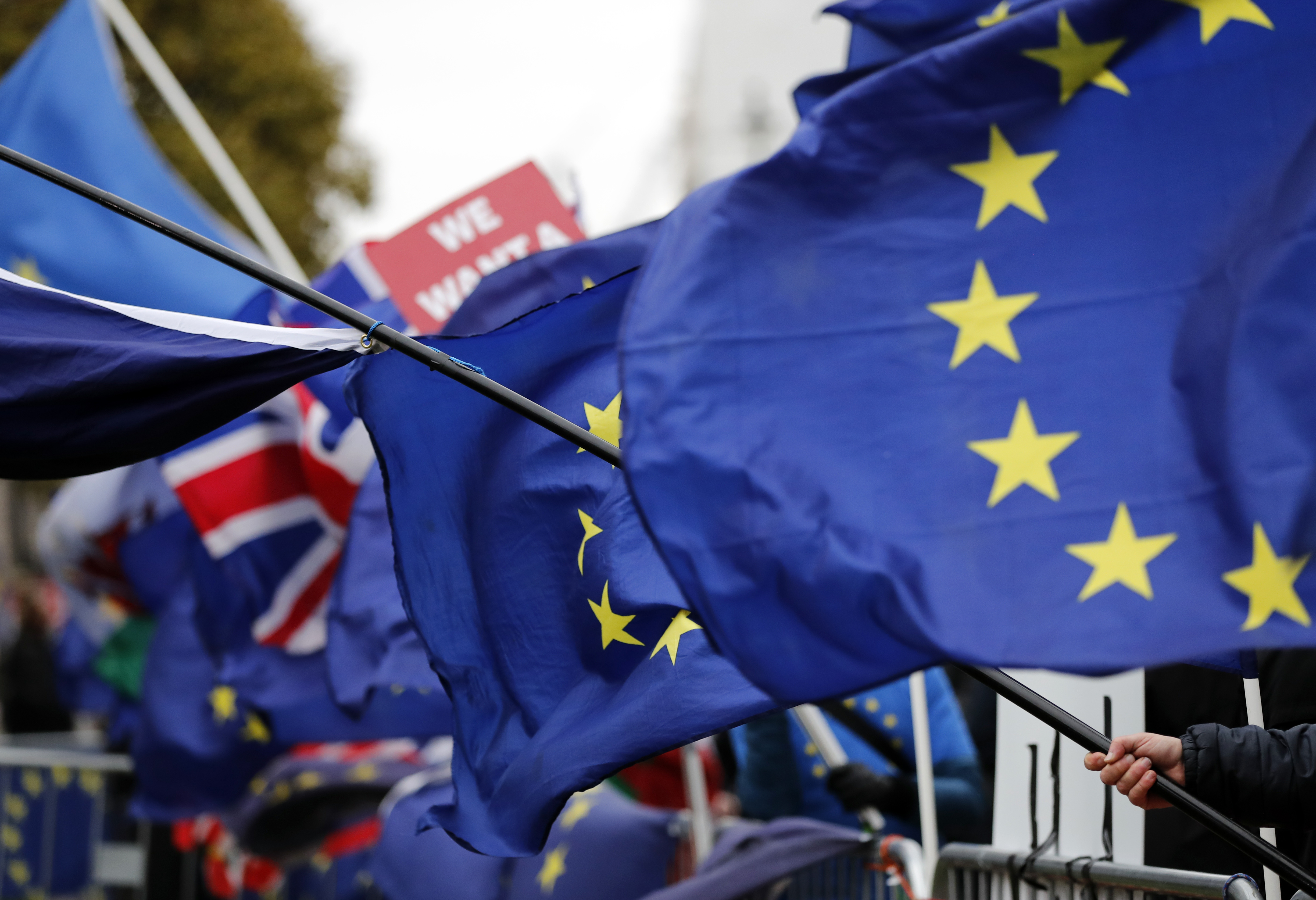 The EU and British flags are seen at the demonstrations area near the parliament building in London, Britain, Jan. 16, 2019.