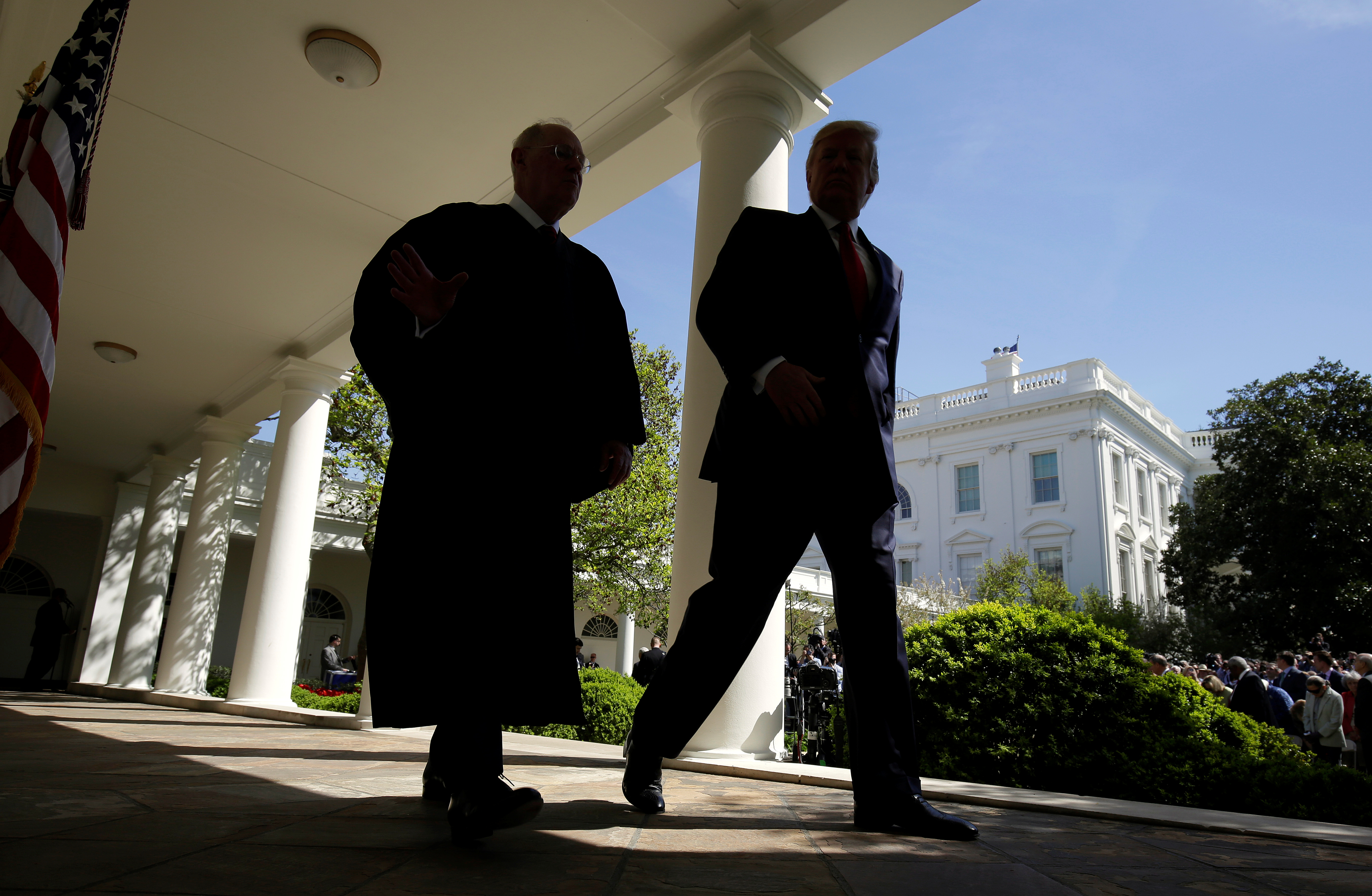 U.S. President Donald Trump walks with Justice Anthony Kennedy after Judge Neil Gorsuch was sworn in as an Associate Supreme Court Justice in the Rose Garden of the White House in Washington, April 10, 2017.