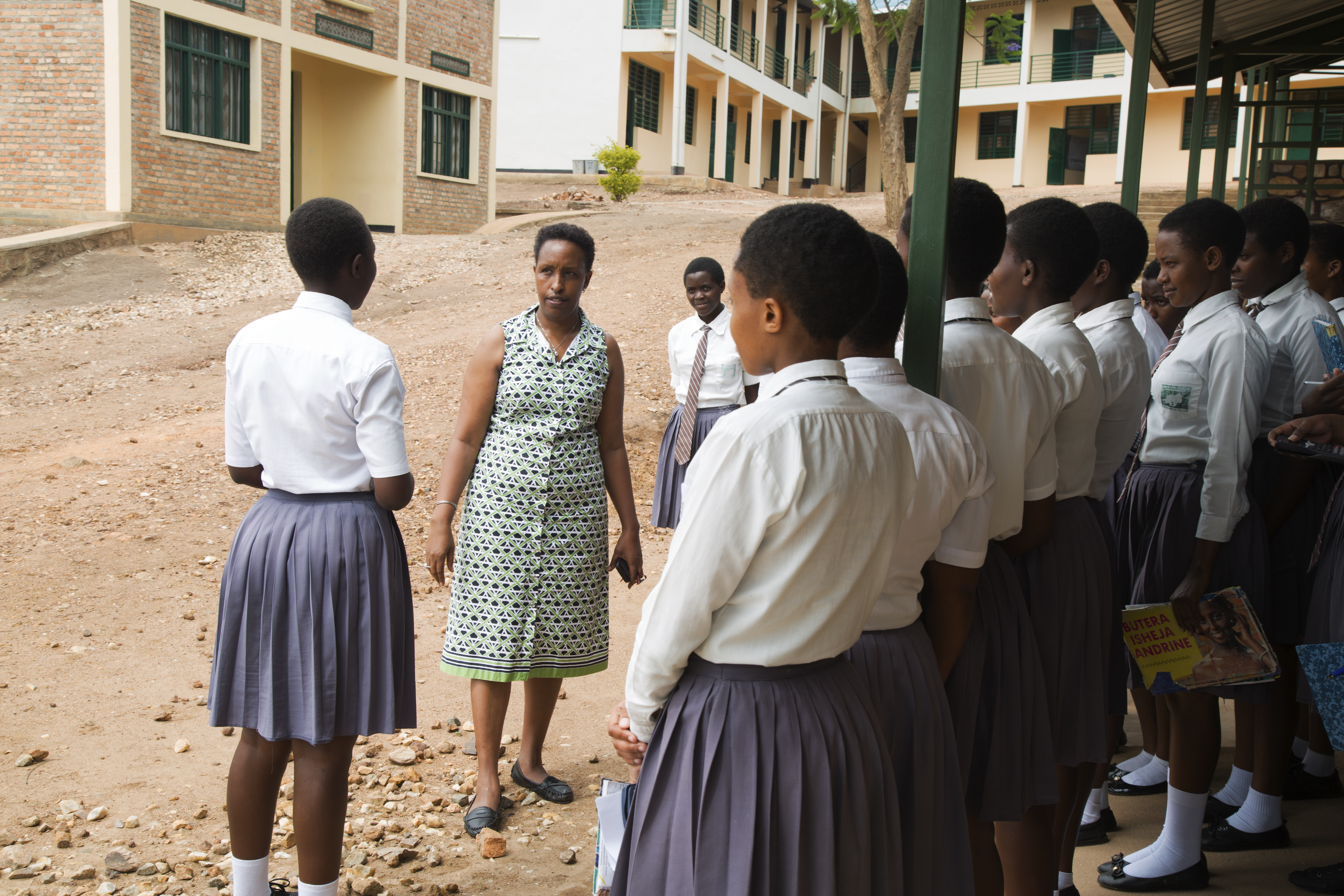 Josephine Kobusingye, an education activist, mentors a group of female science students. She says supporting them is crucial because many of them are facing dificult family situations.
