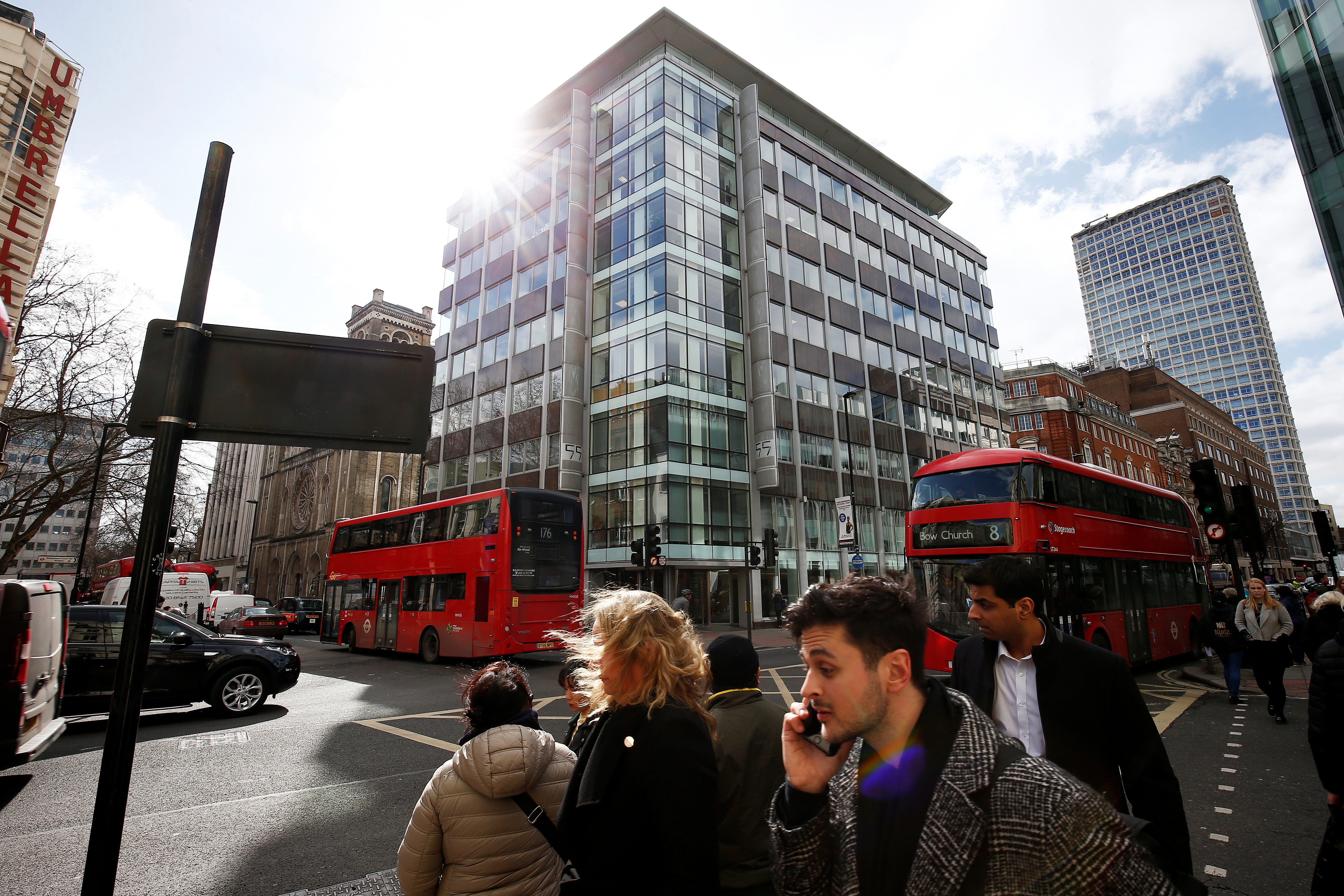 People walk past the building housing the offices of Cambridge Analytica in central London, Britain, March 20, 2018.